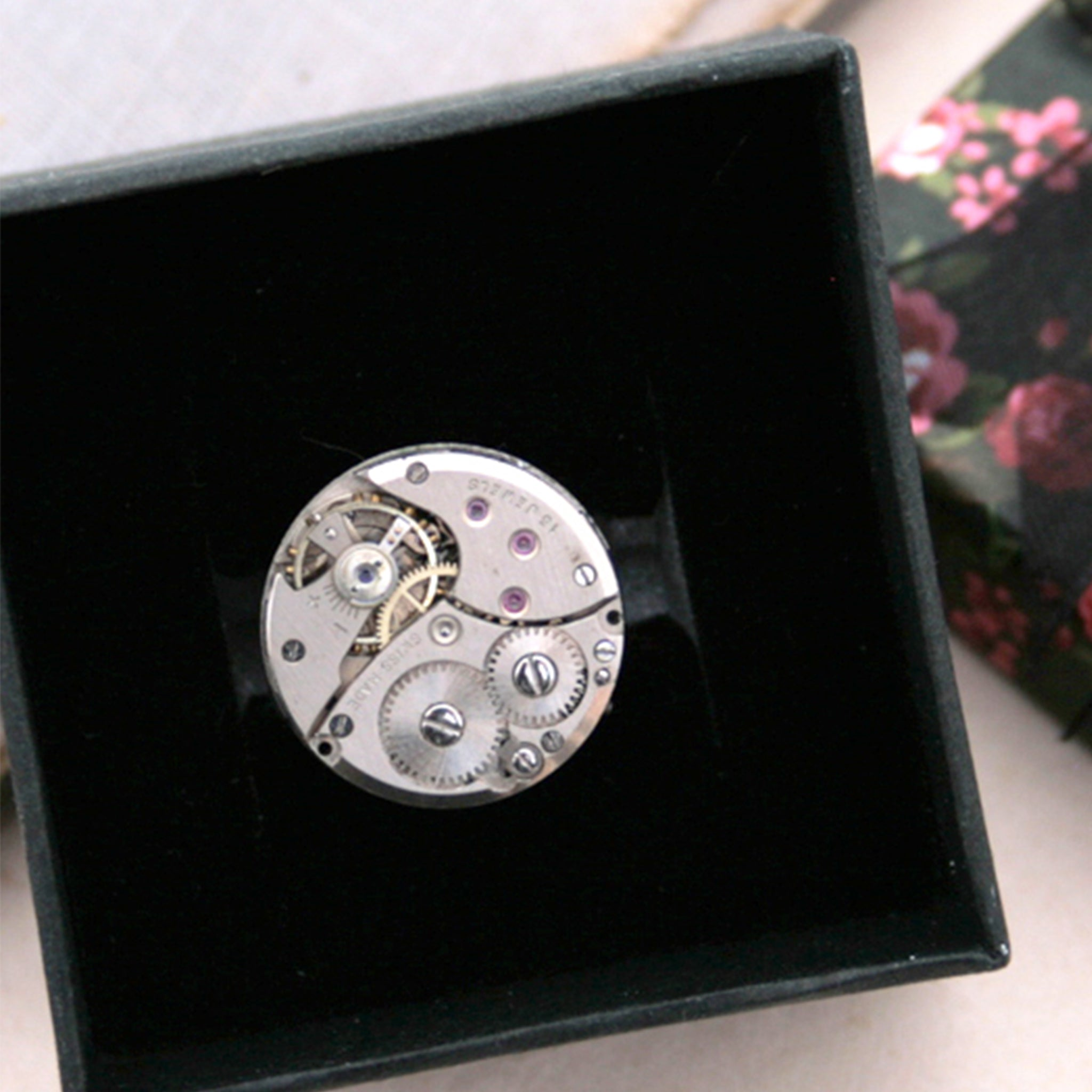 steampunk ring made of a real Swiss watch mechanism in a box