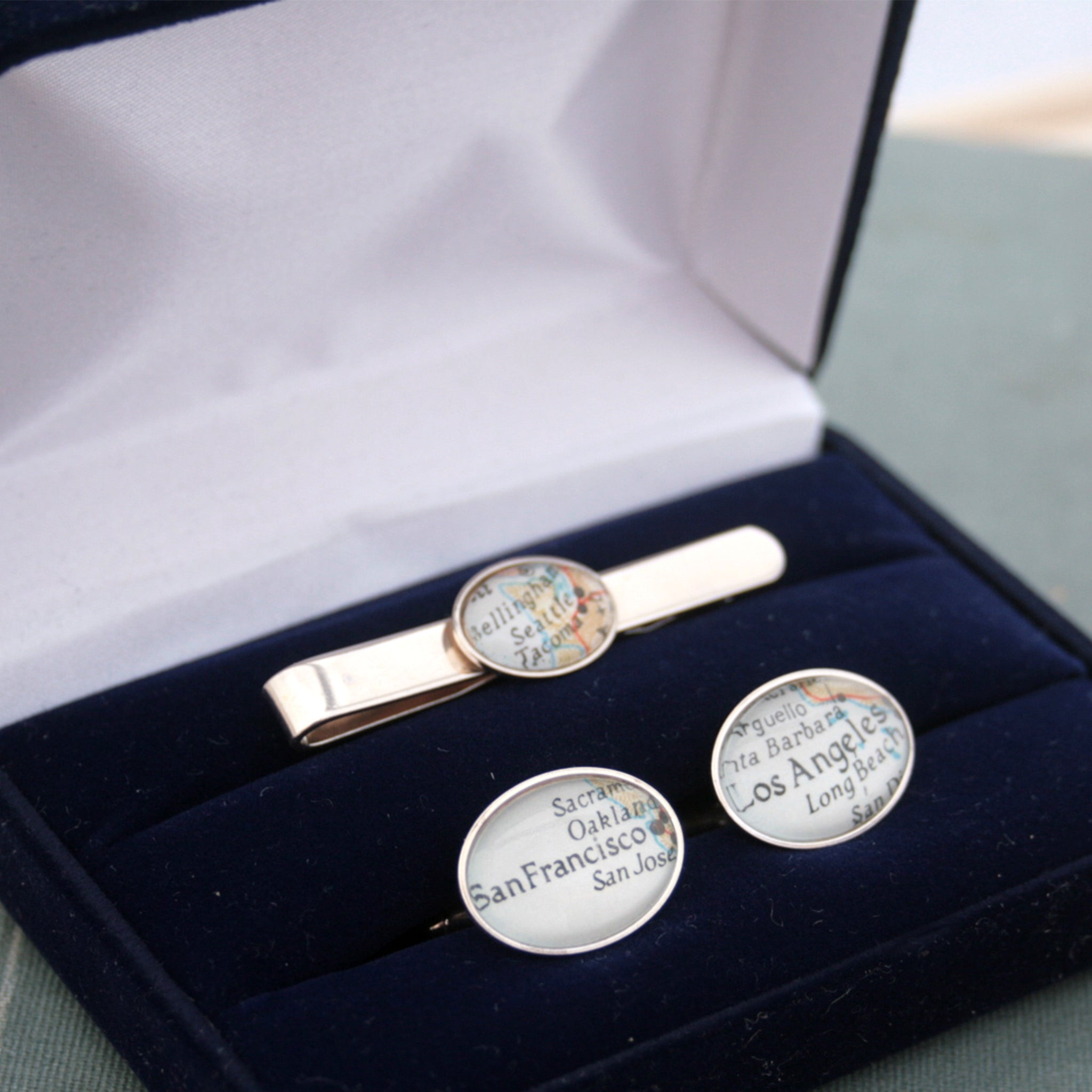 Sterling Silver Tie Clip and Cufflinks set featuring custom map locations in a blue presentation box