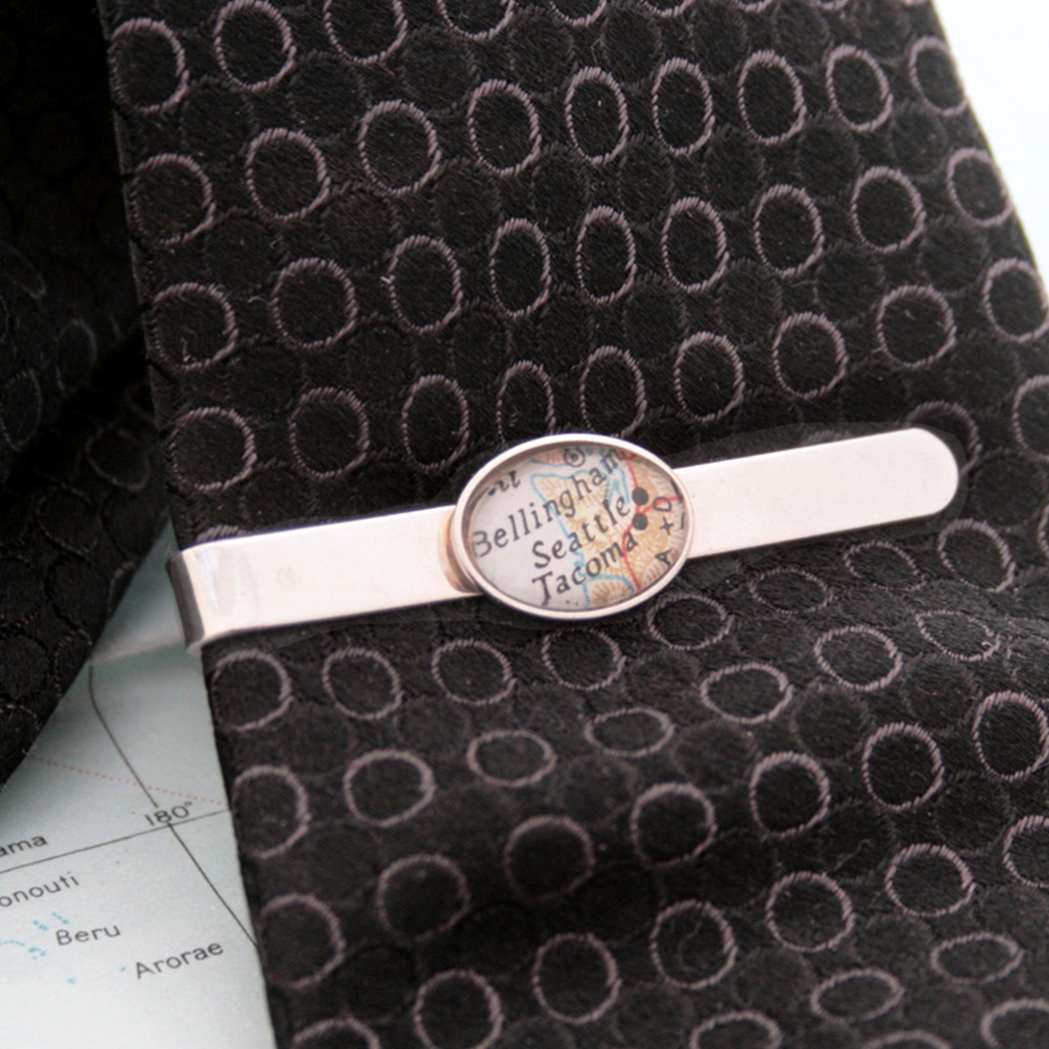 Sterling Silver tie clip that features custom map location on a black tie