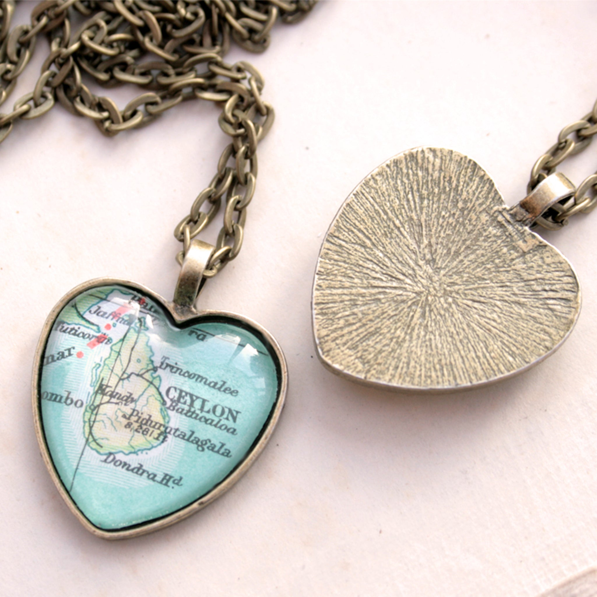 Heart shaped pendant necklace in bronze tone featuring map of Ceylon