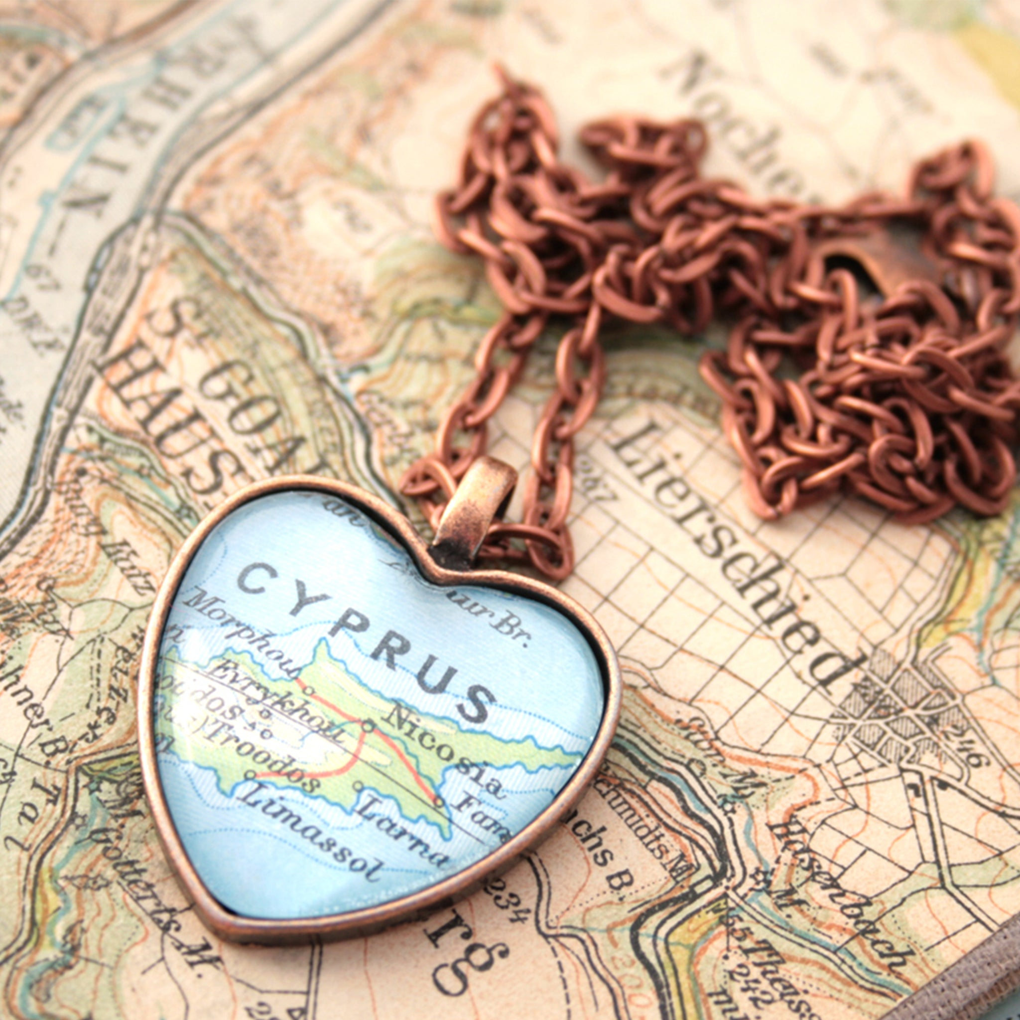 Heart shaped pendant necklace in copper tone featuring map of Cyprus