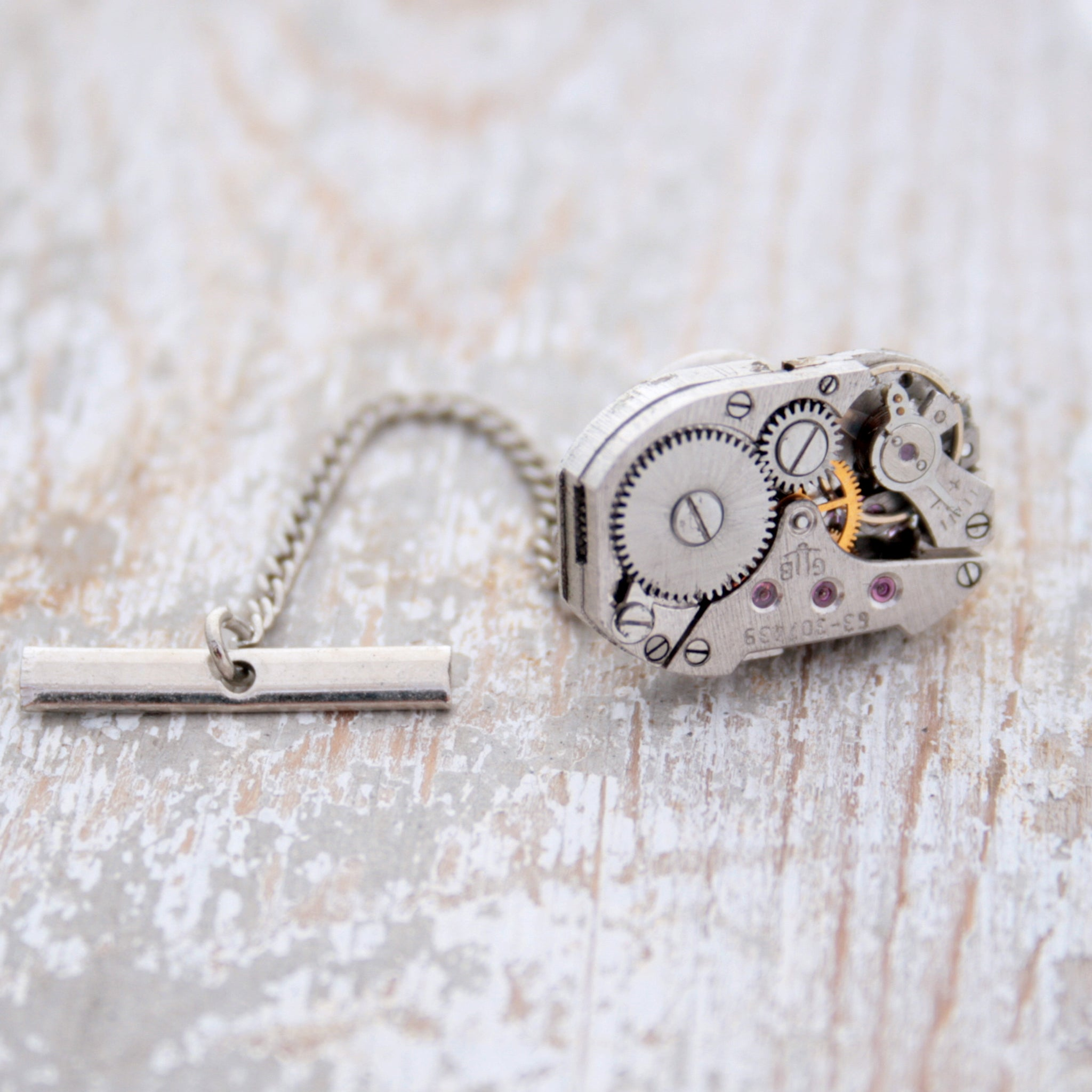 Tie Tack with antique watch movement