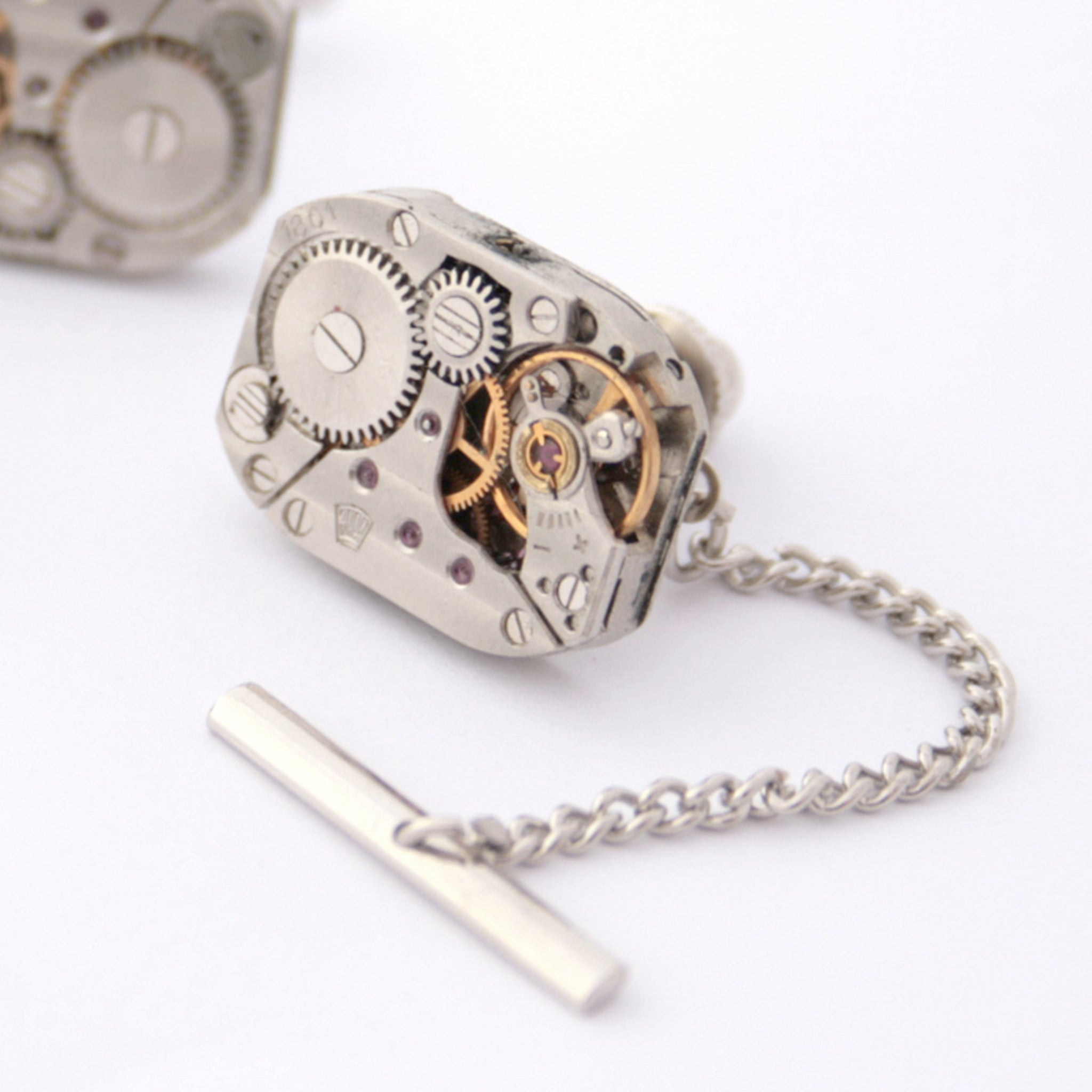 Tie tack made of watch movement