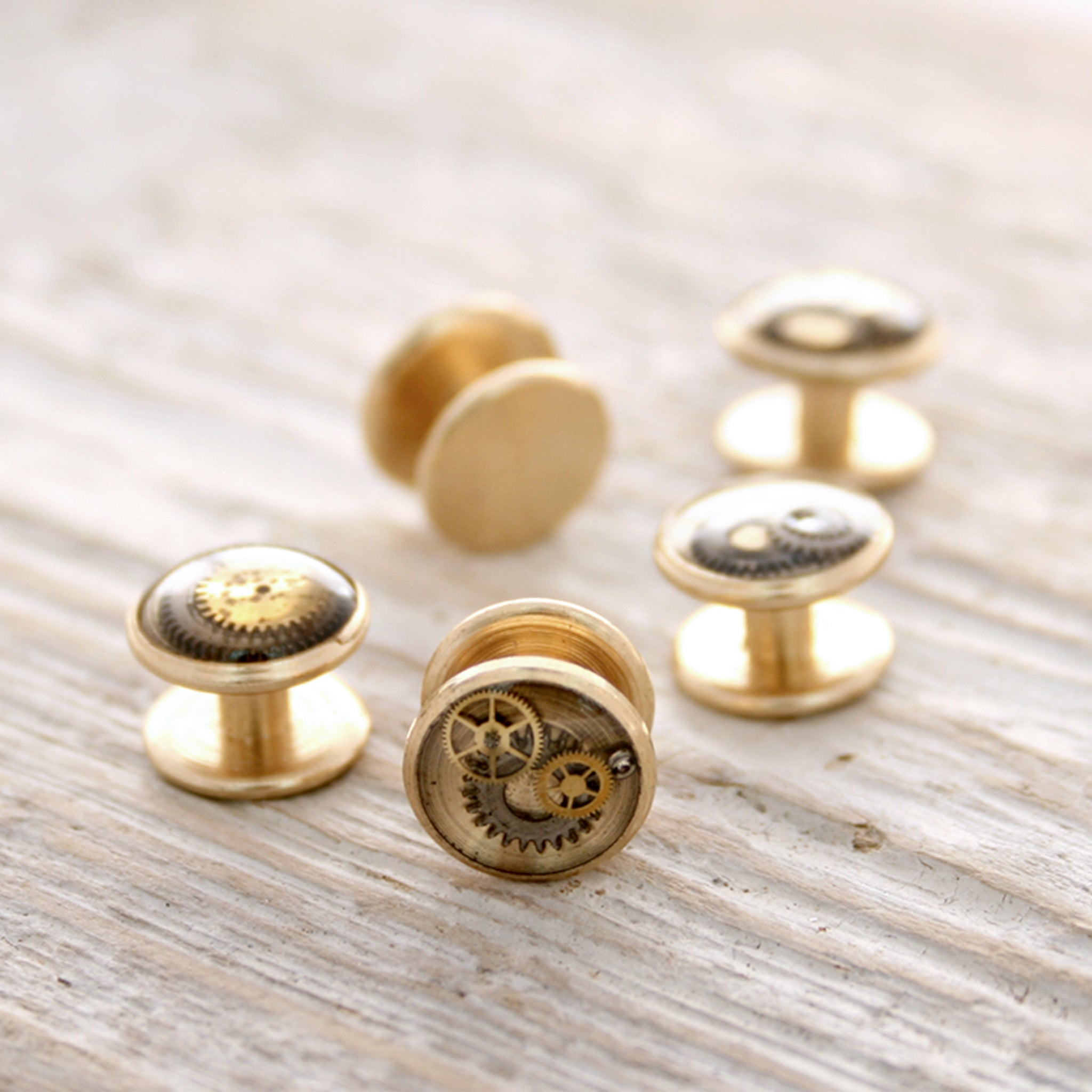 Little tuxedo studs made of raw brass, watch parts and resin