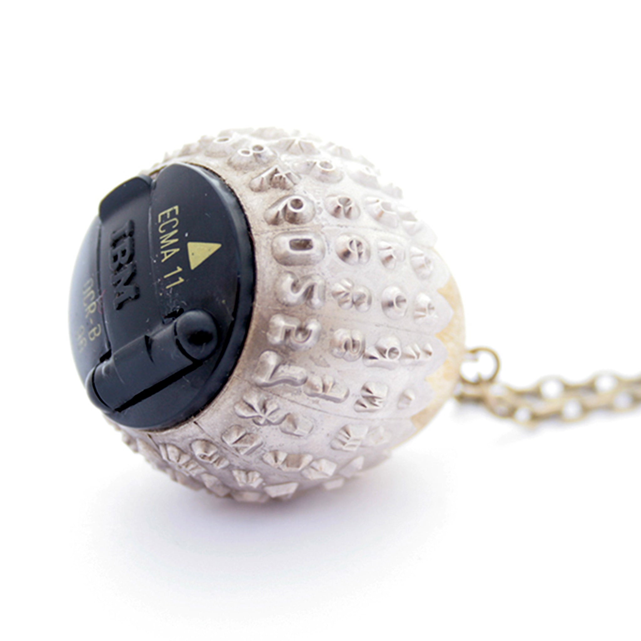 IBM Selectric typewriter font ball with large gold tone bead turned into eye catching necklace