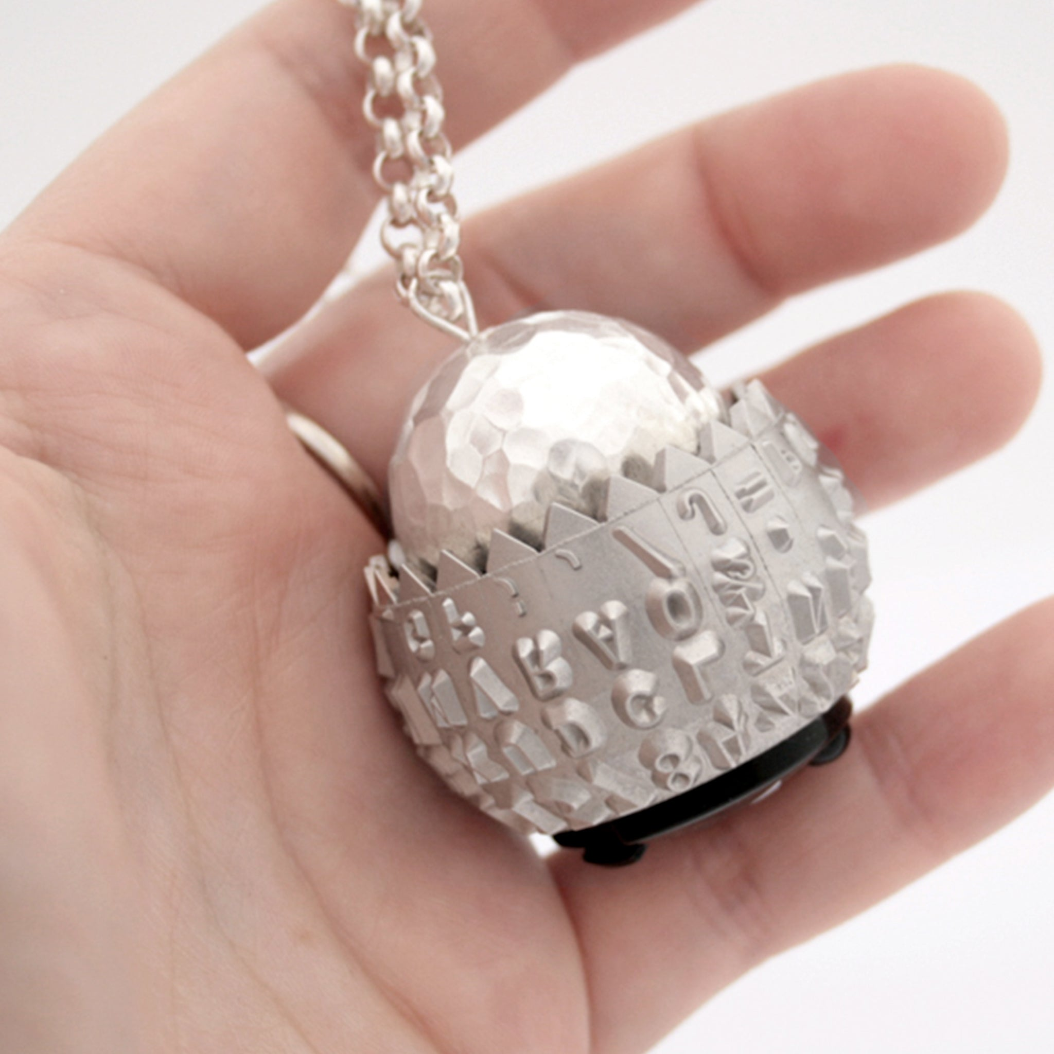 IBM Selectric typeball with sterling silver bead turned into quirky necklace