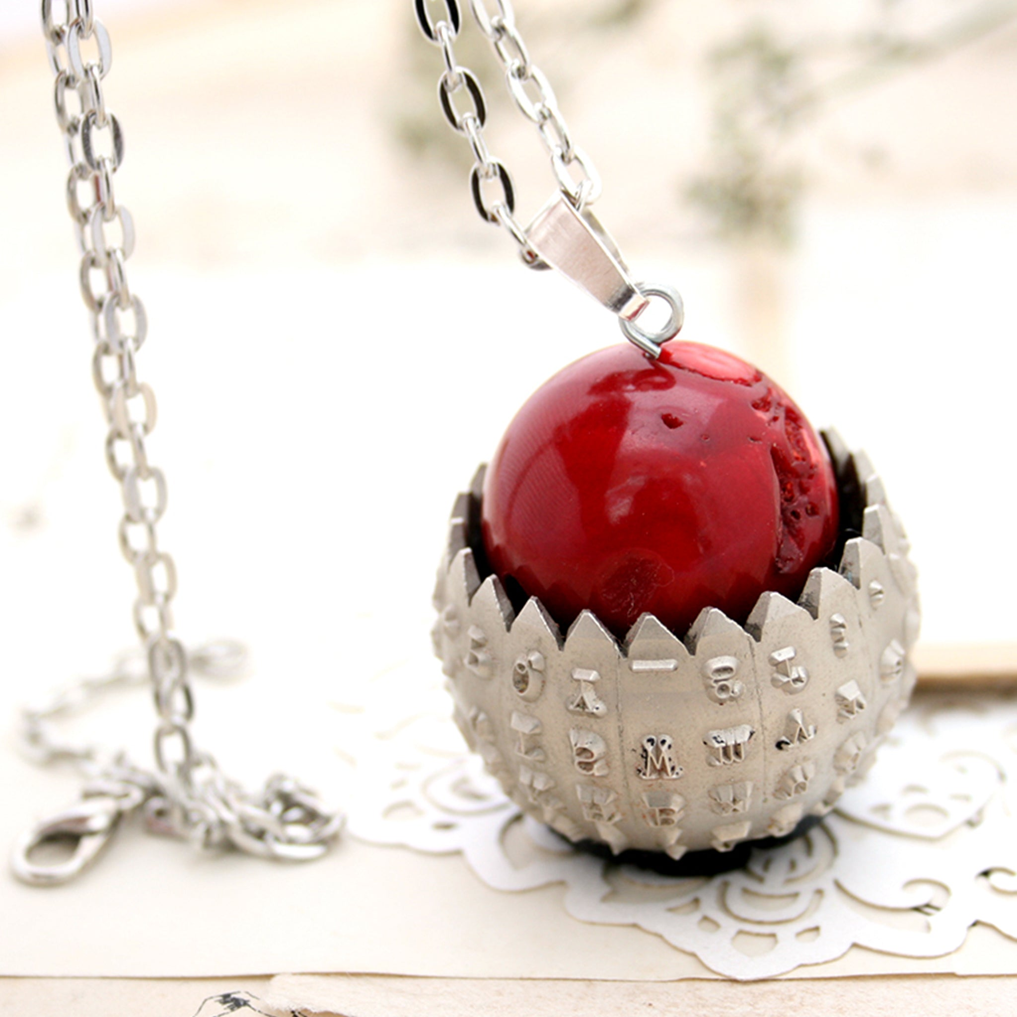 IBM Selectric typewriter font ball with large coral bead turned into eye catching necklace