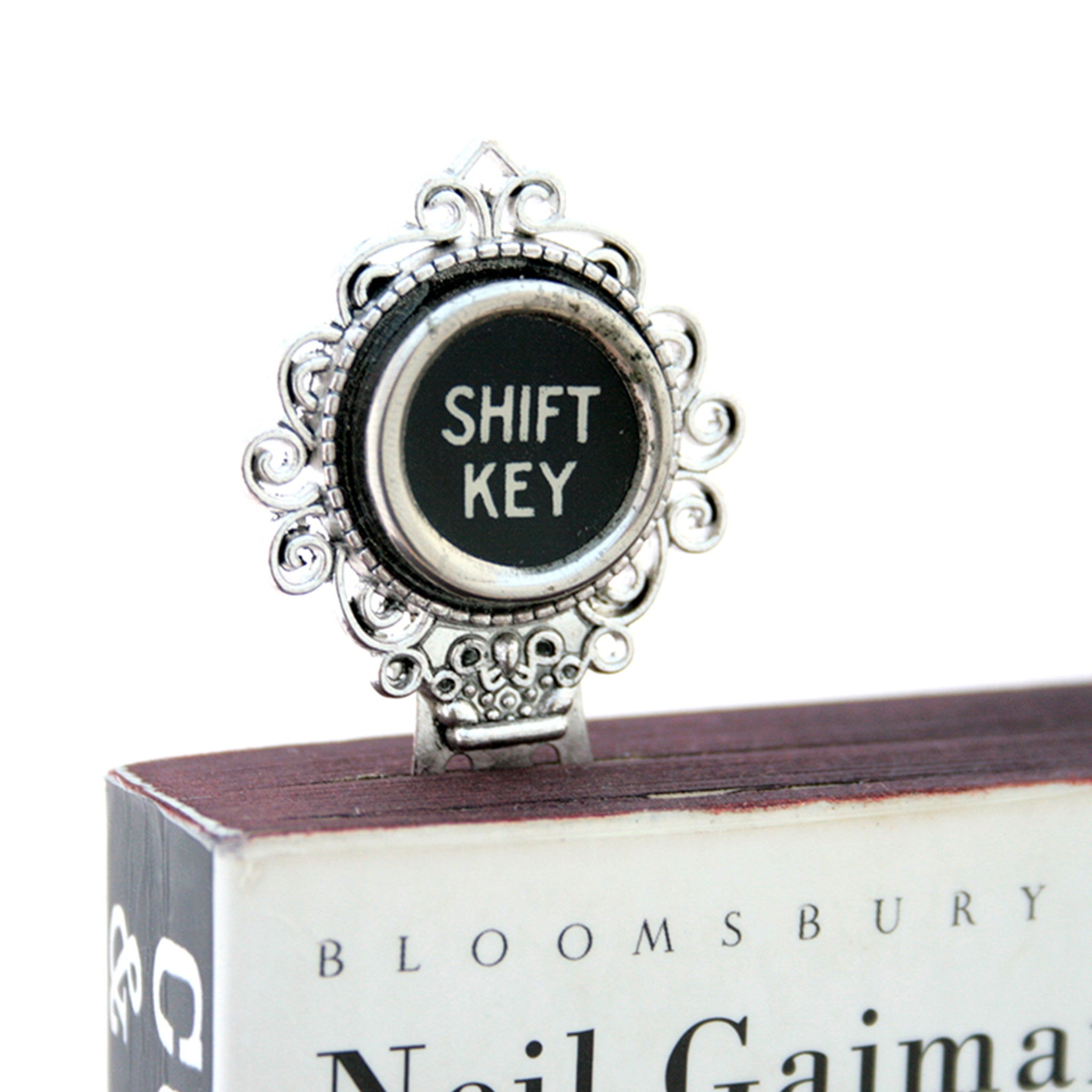 Metal bookmark made of real Shift Key from the typewriter in a book