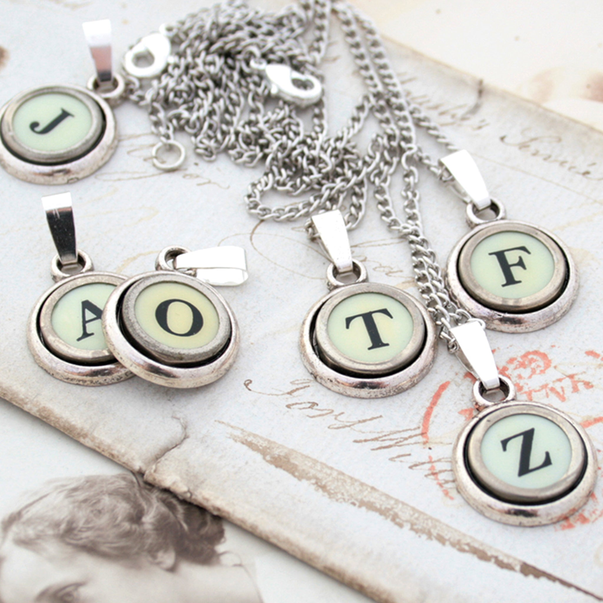 Ivory initial necklaces made of  typewriter keys