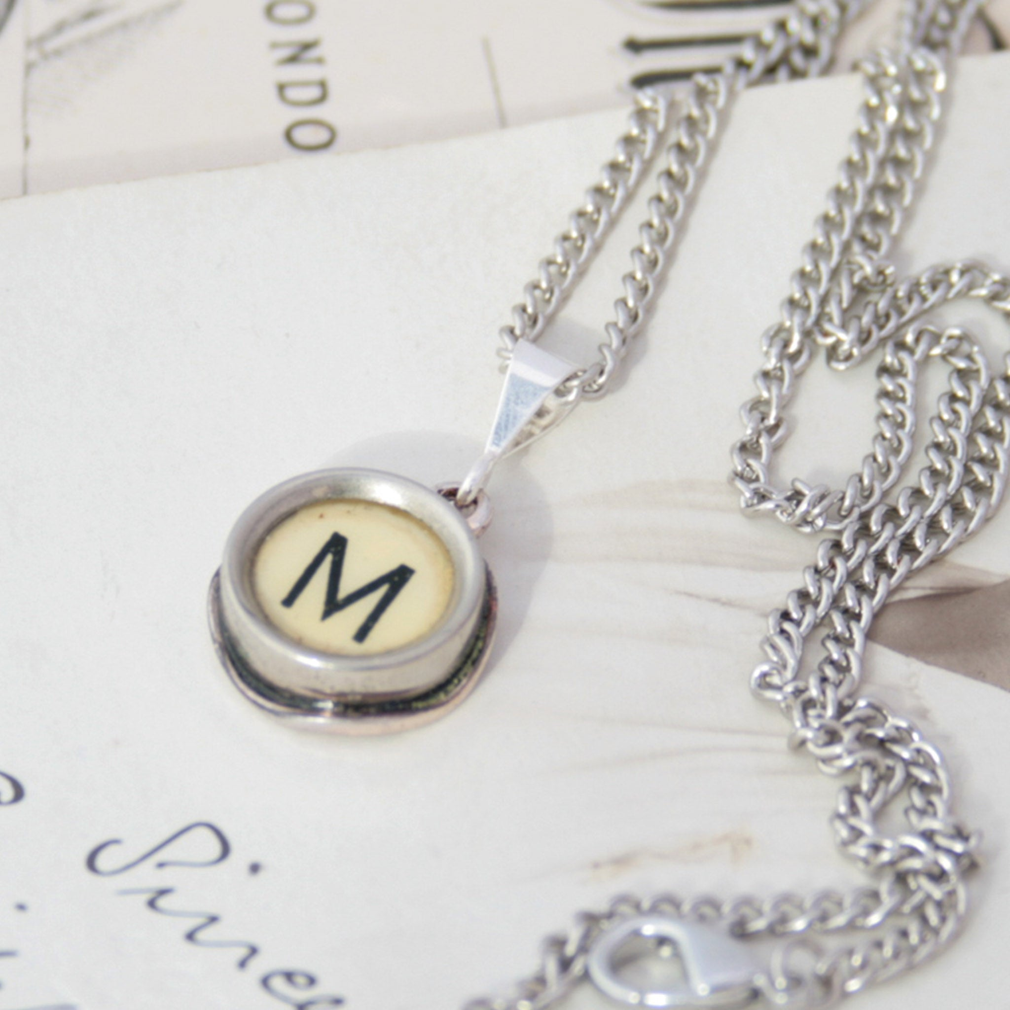 M letter necklace in ivory color made of vintage typewriter key
