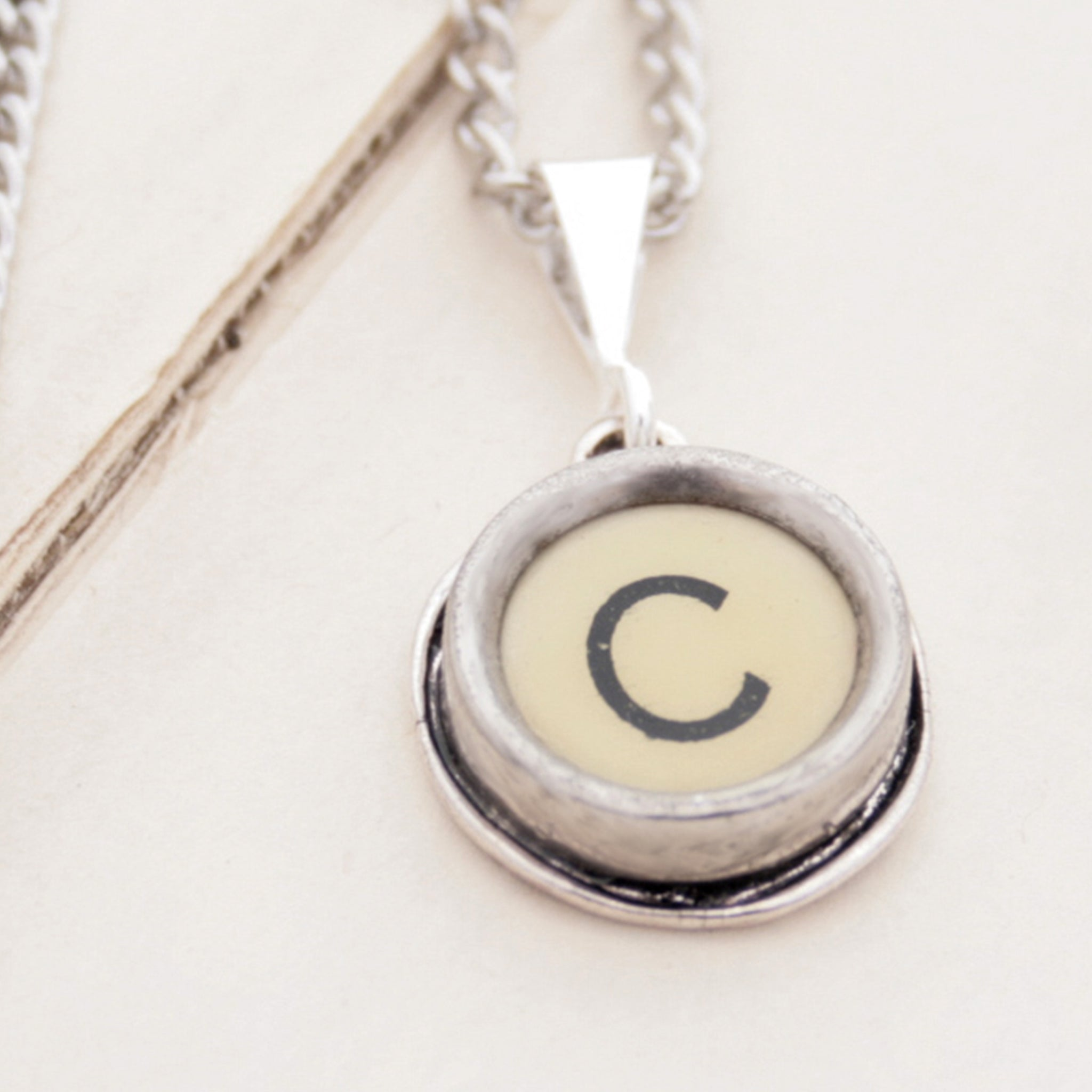 C letter necklace in ivory color made of vintage typewriter key
