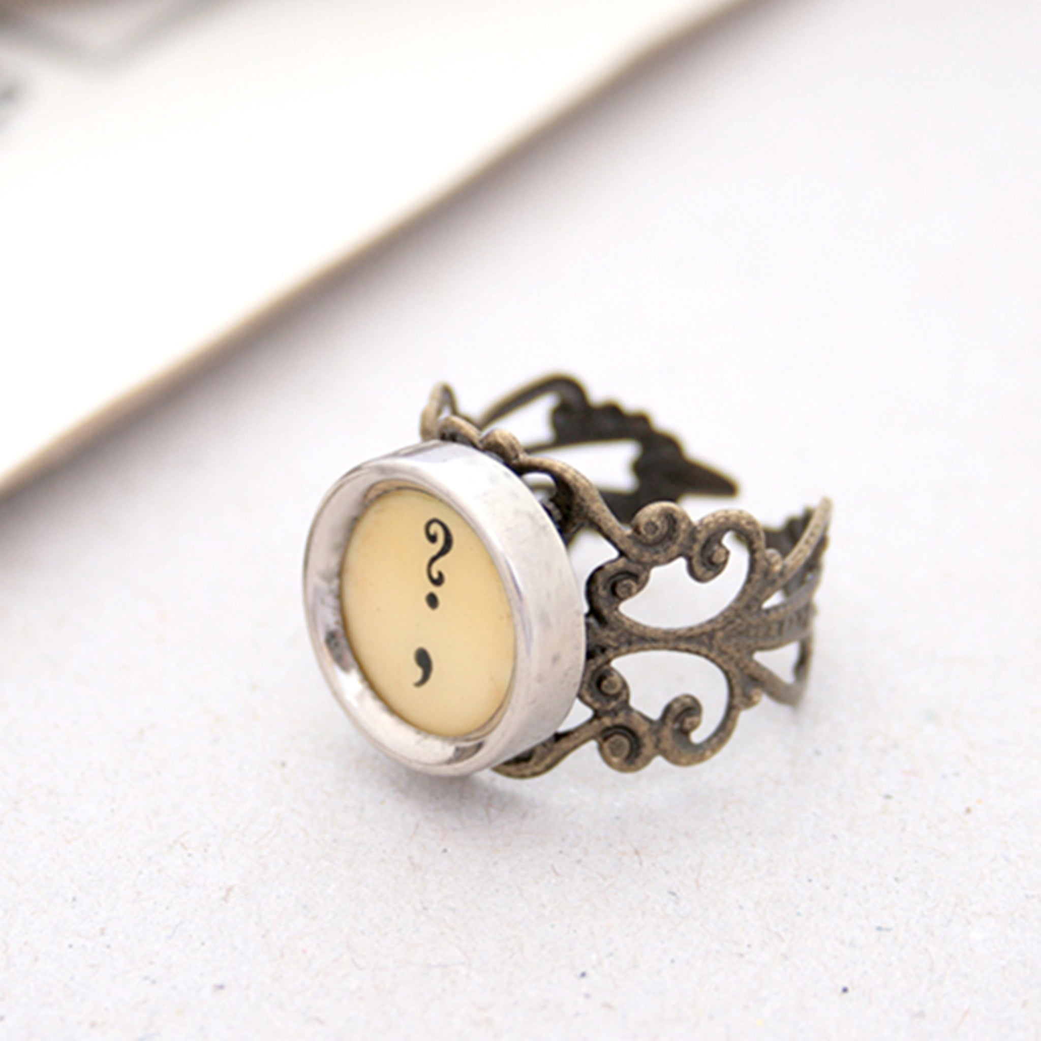 Ring with question mark and comma made of  typewriter key in ivory color