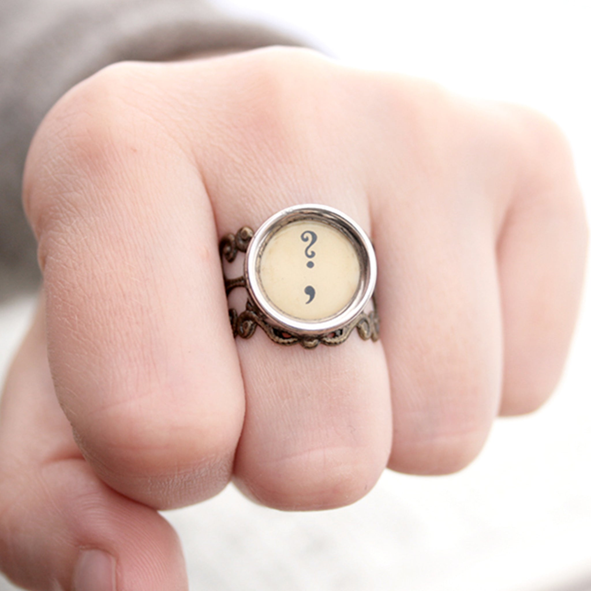 Ring with question mark and comma made of  typewriter key in ivory color worn on hand