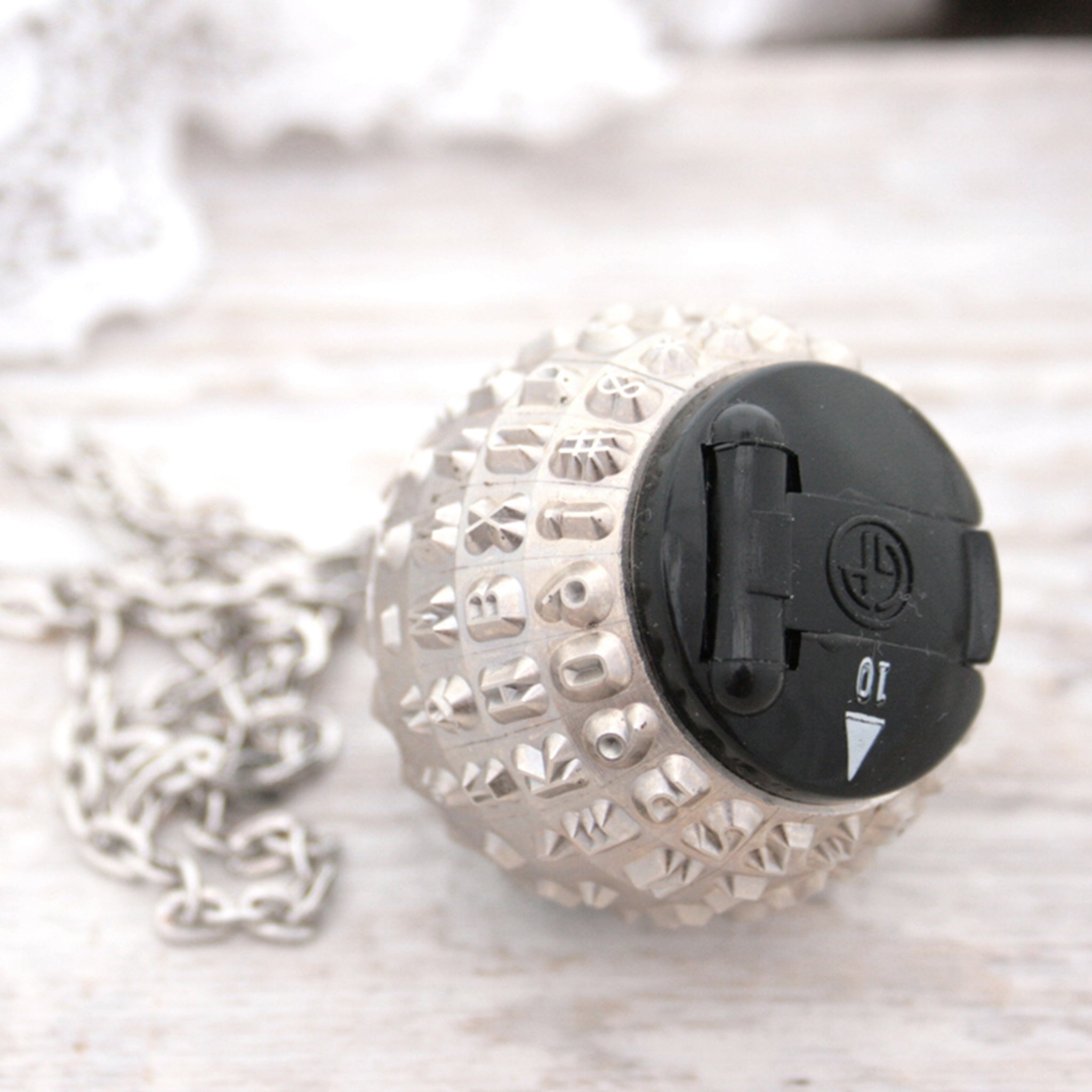 IBM Selectric typewriter font ball with large black and white bead turned into a necklace
