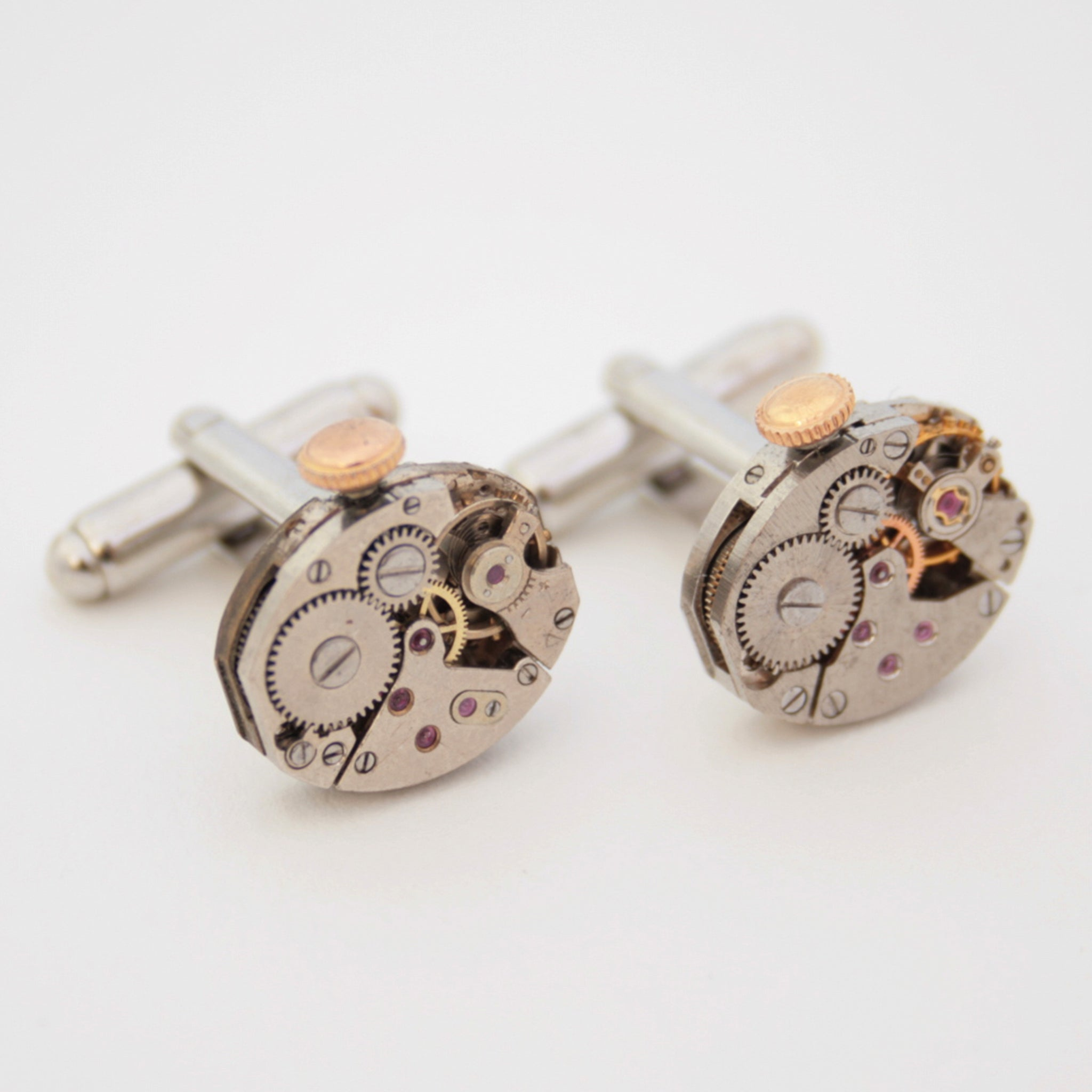 steampunk wedding cufflinks featuring antique watch movements with wind ups