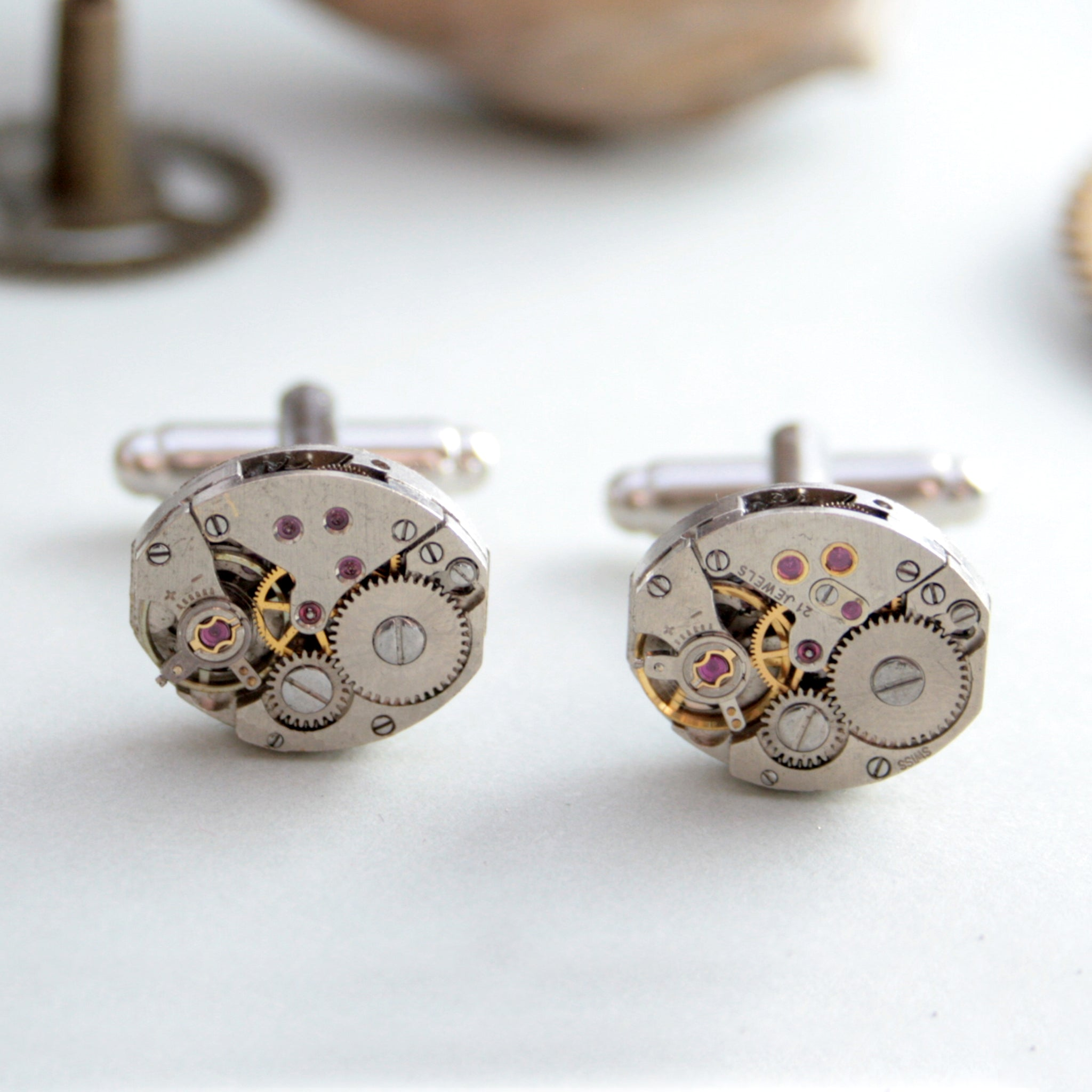 steampunk womens cufflinks featuring antique watch movements