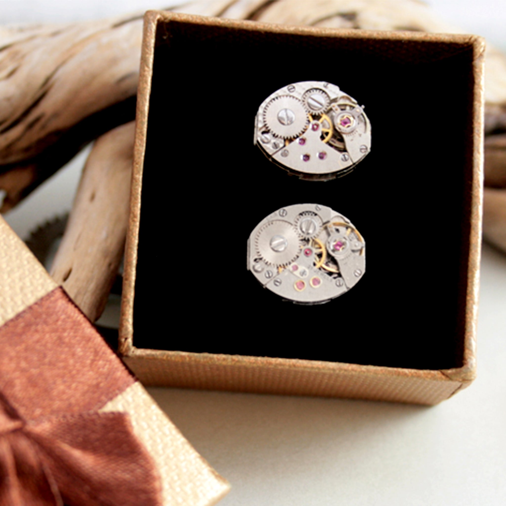 steampunk womens cufflinks featuring antique watch movements in a brown box