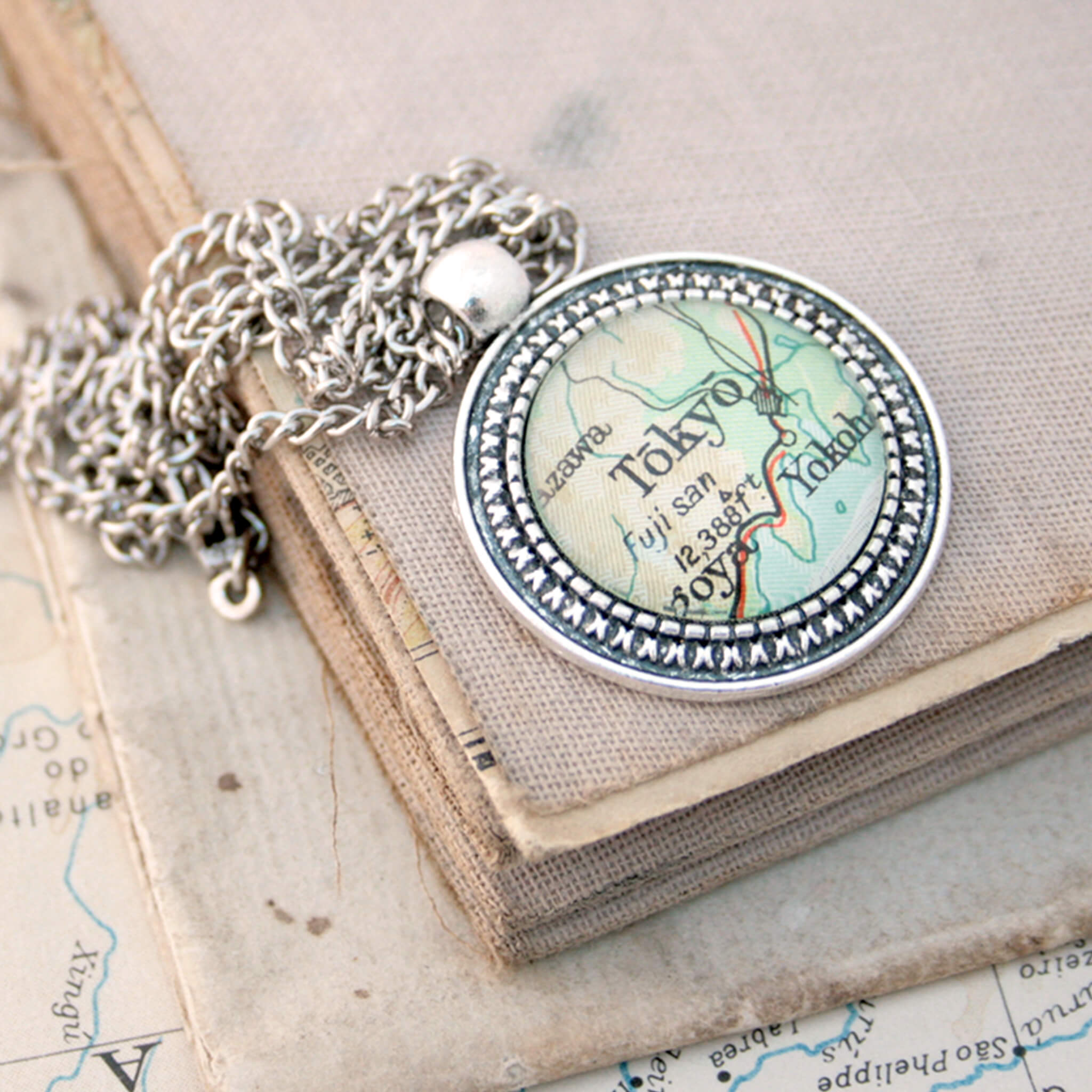 Silver coloured pendant necklace with map of Tokyo
