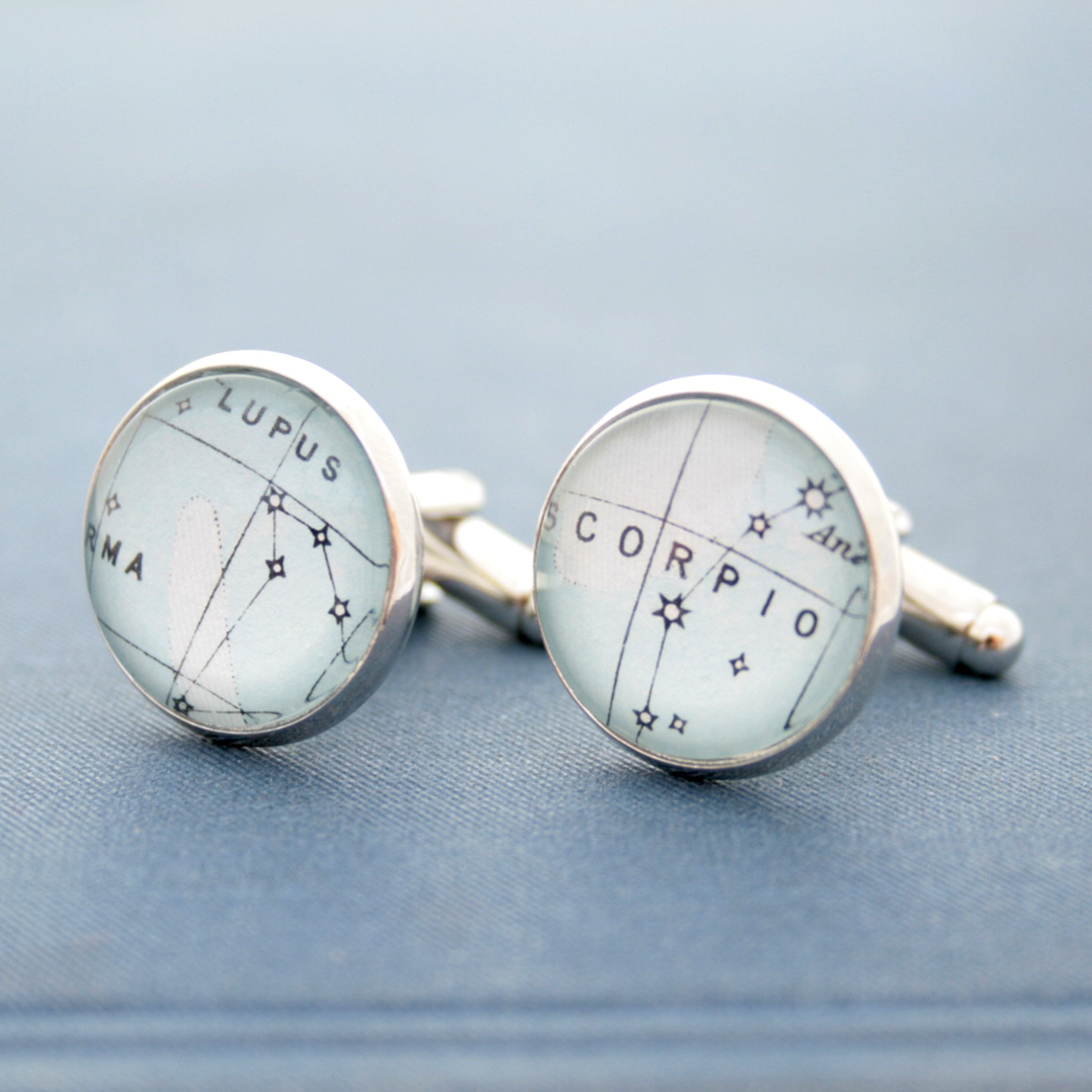 Blue cufflinks on silver blanks featuring star constellations