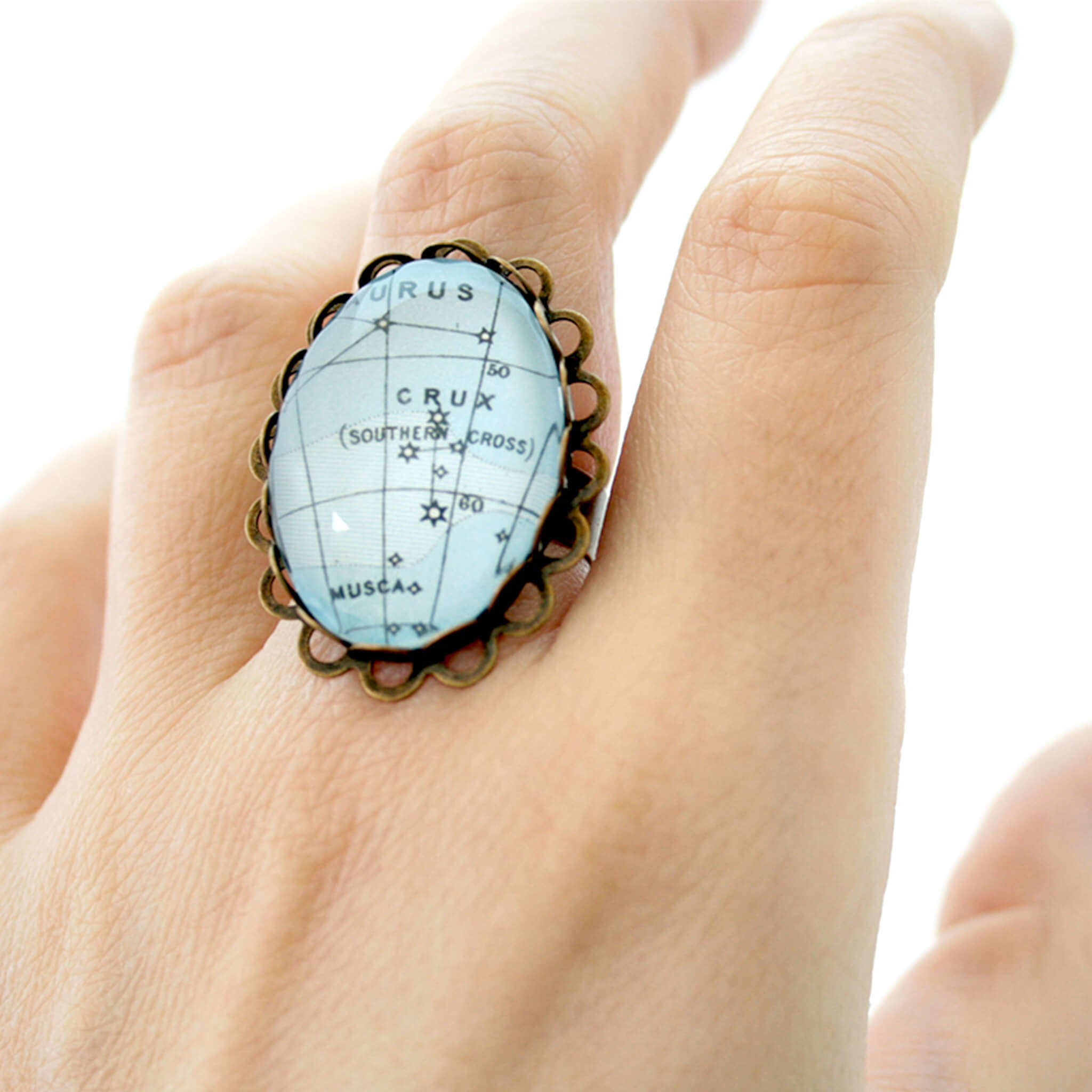 Oval, bronze star constellation ring in blue color
