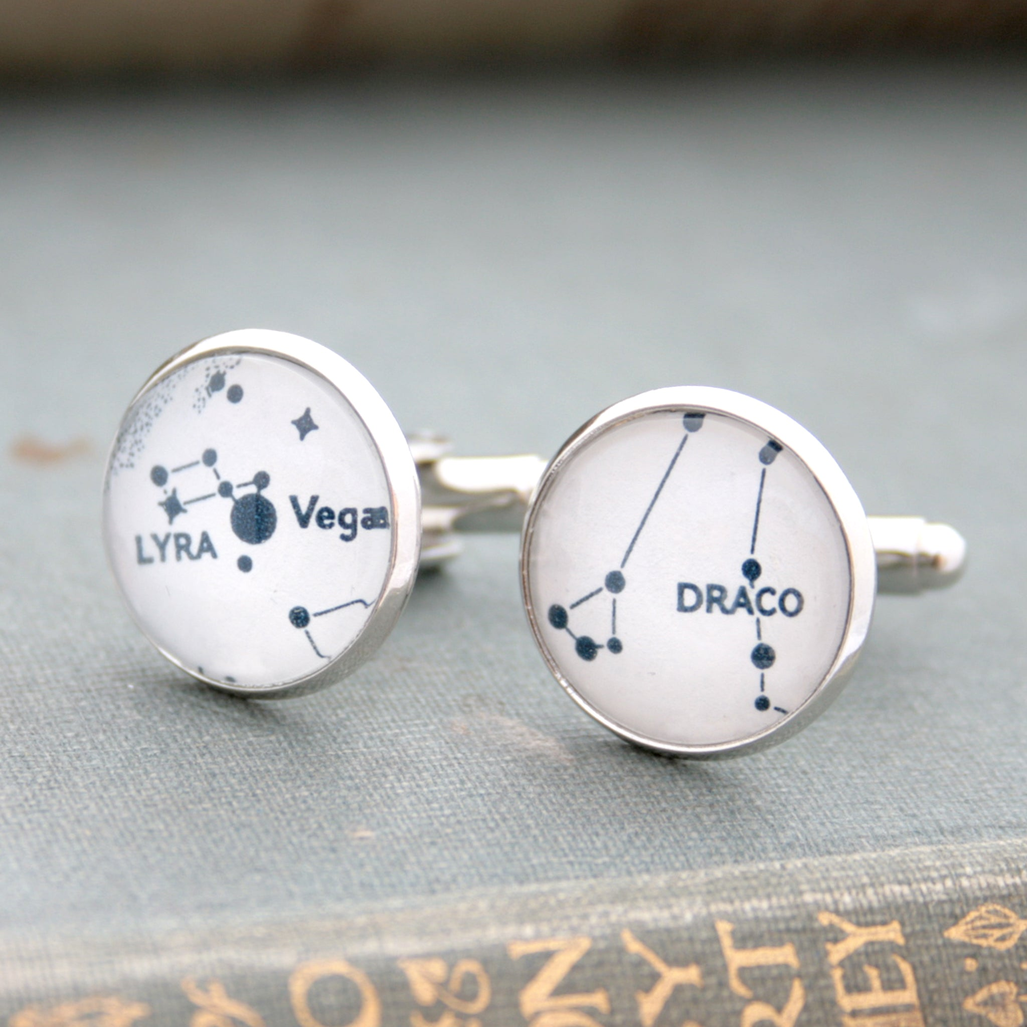 White cufflinks on silver blanks featuring Lyra and Draco star constellations