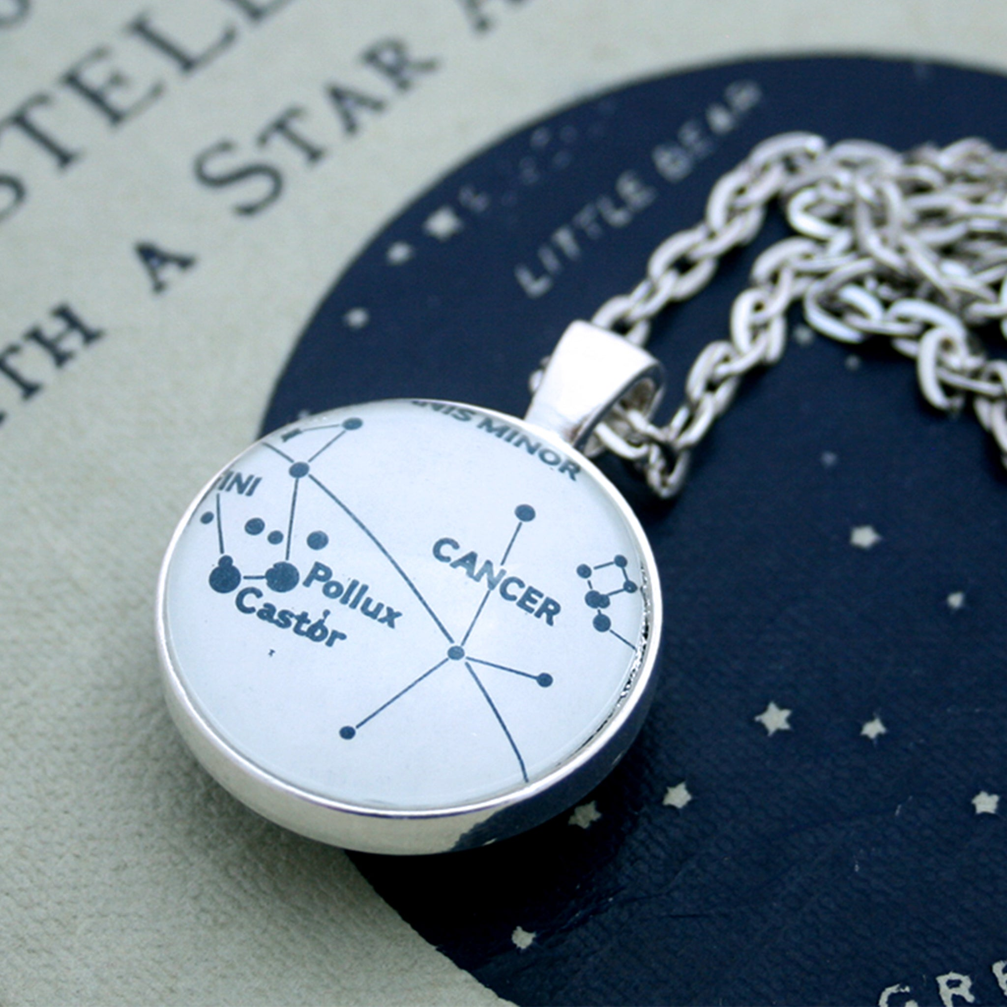 Silver double sided celestial necklace with  zodiac signs or star constellations