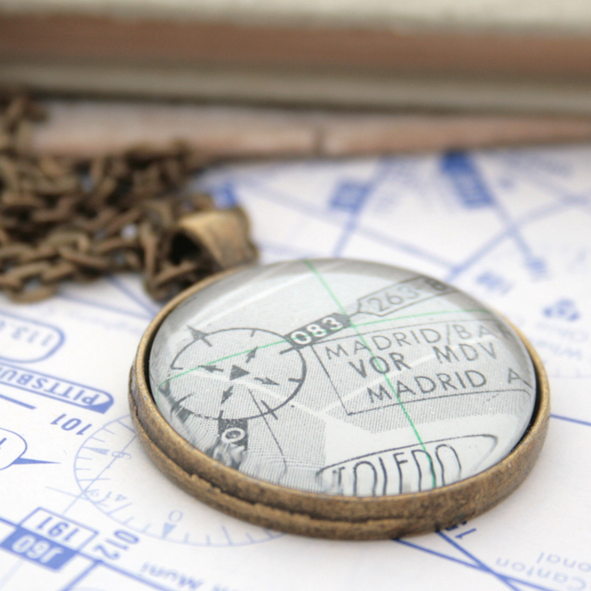 Bronze pendant necklace featuring custom pilots chart