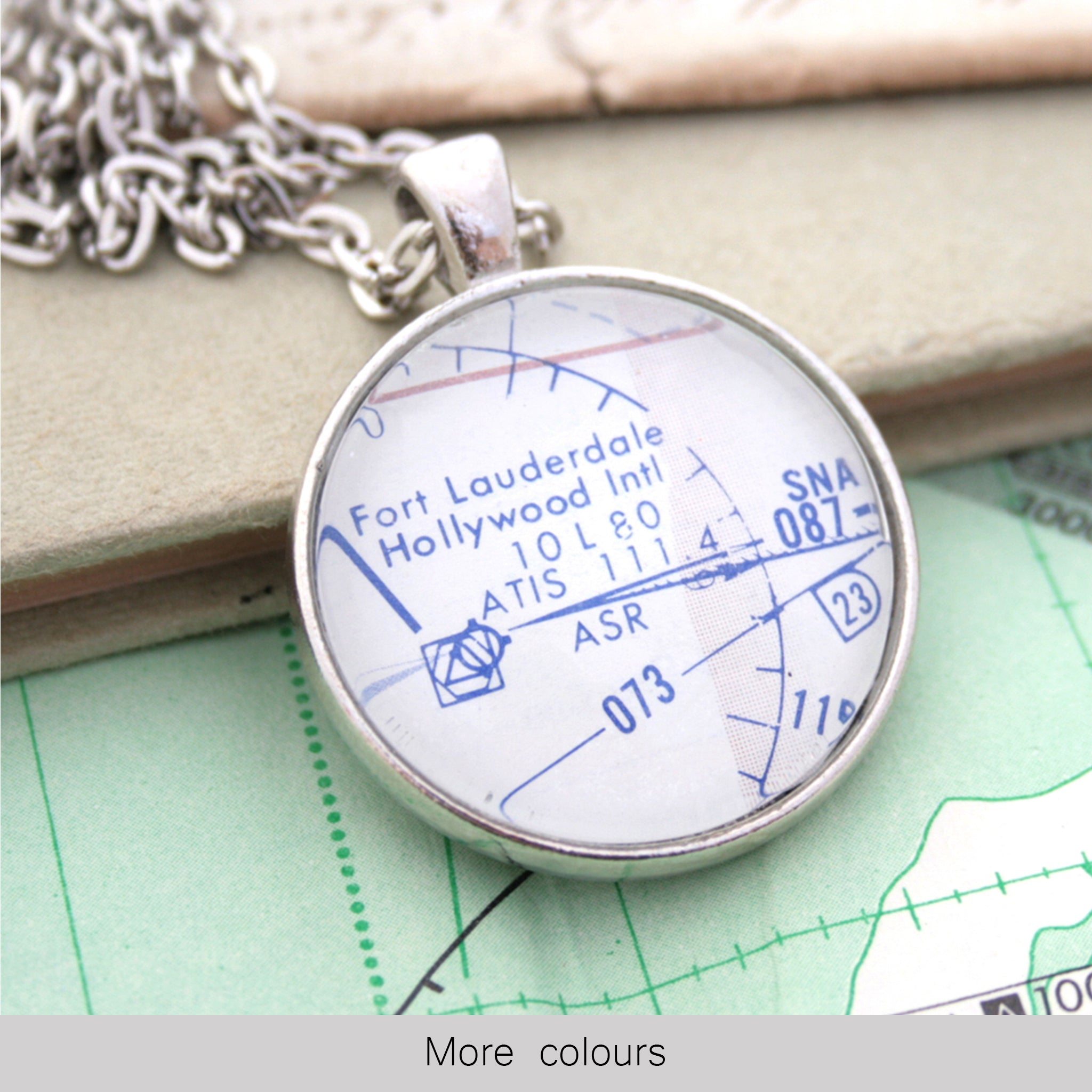 Silver pendant necklace featuring custom pilots chart