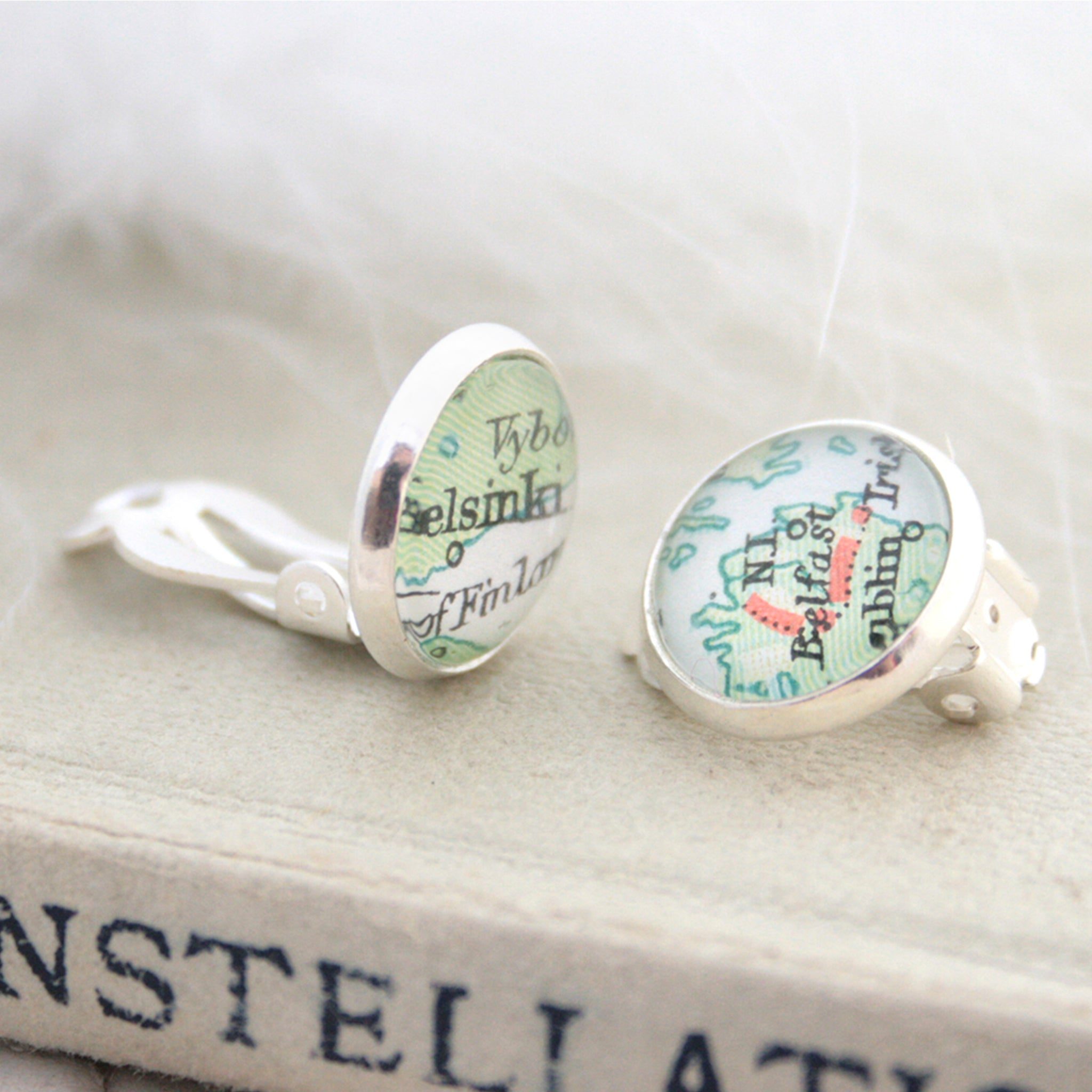 Custom clip on earrings in silver tone featuring vintage maps