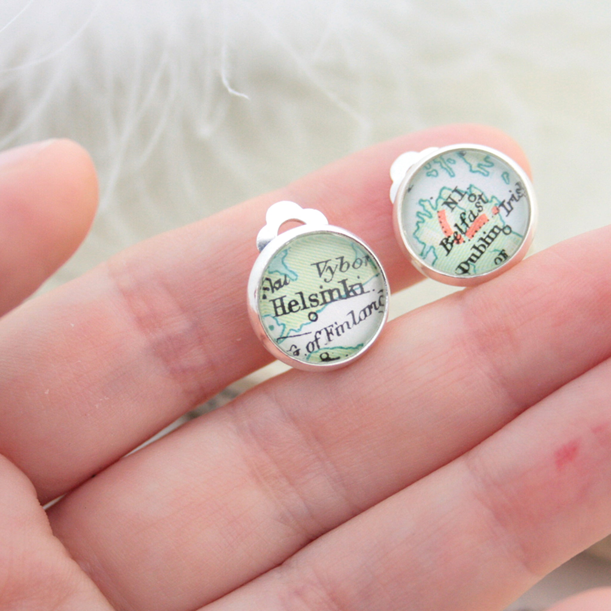 hold in hands Custom clip on earrings in silver tone featuring vintage maps