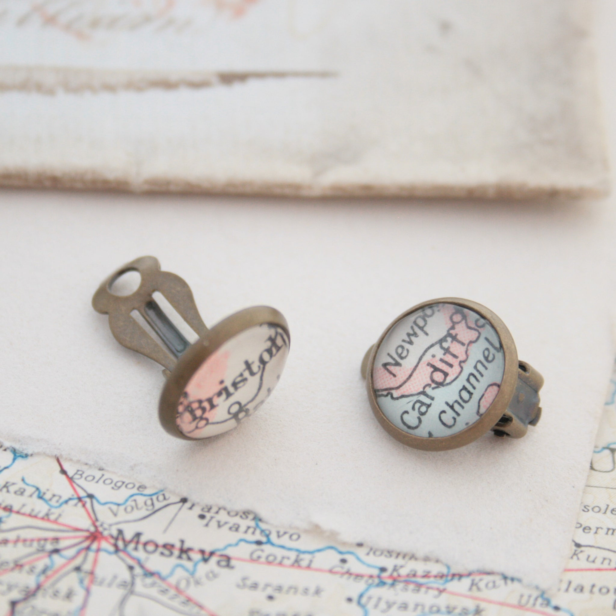 Custom clip on earrings in bronze tone featuring vintage maps