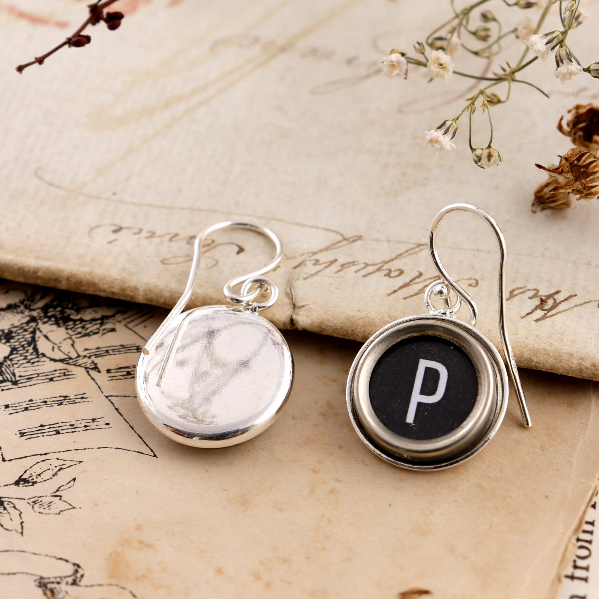 Black initial earrings P made of old typewriter keys one is turned