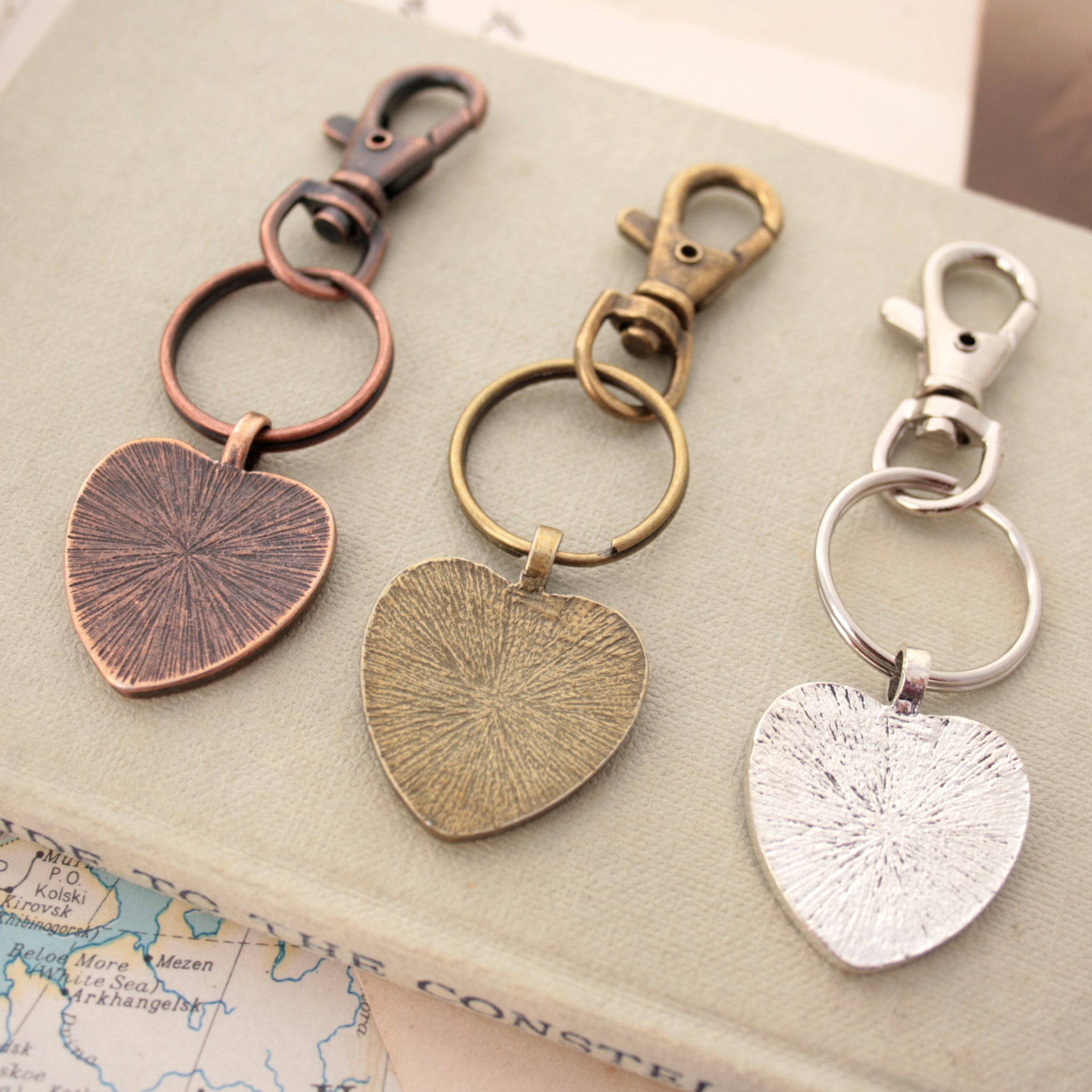 Copper, bronze and silver tone keychains in heart shape