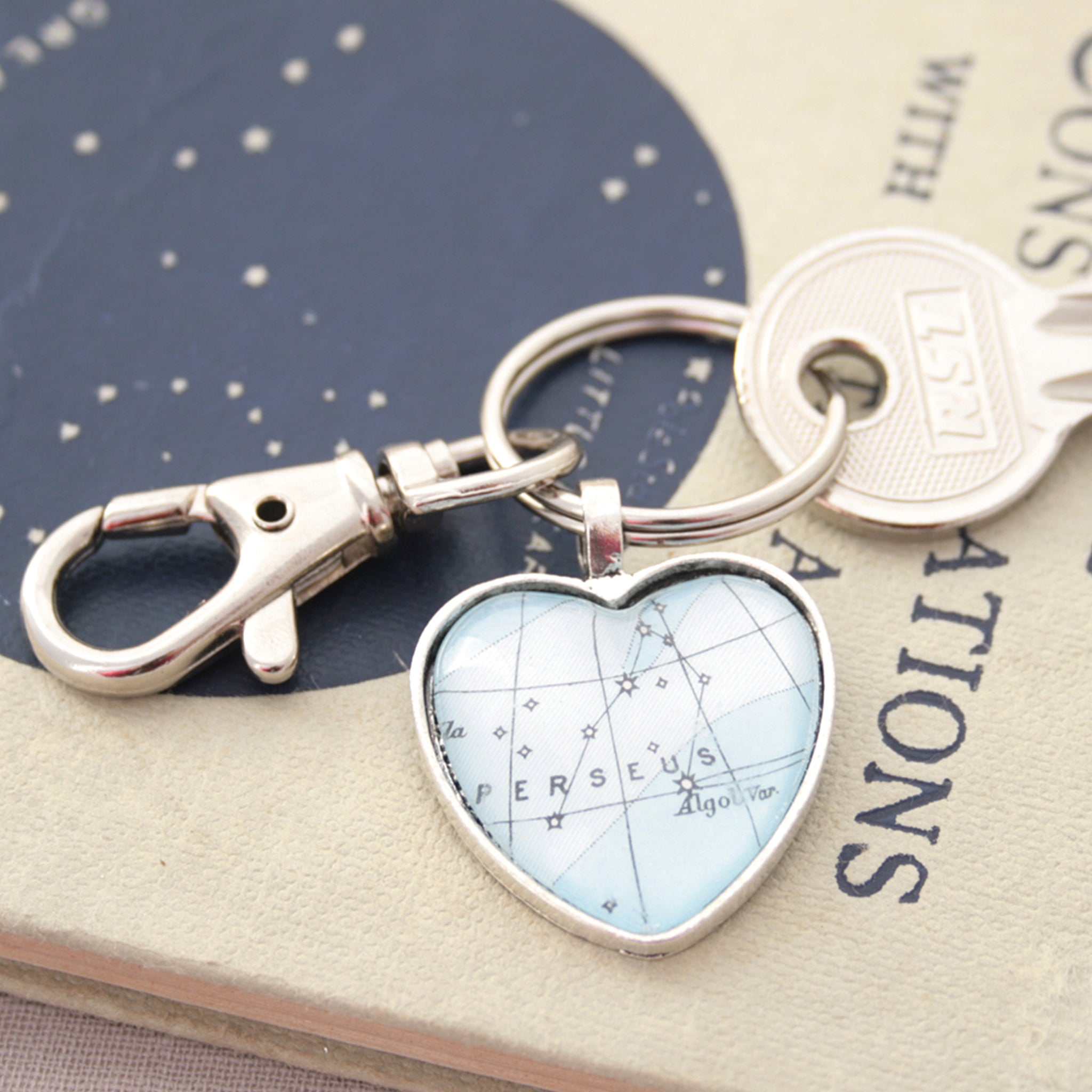 Blue Perseus zodiac keychain in heart shape