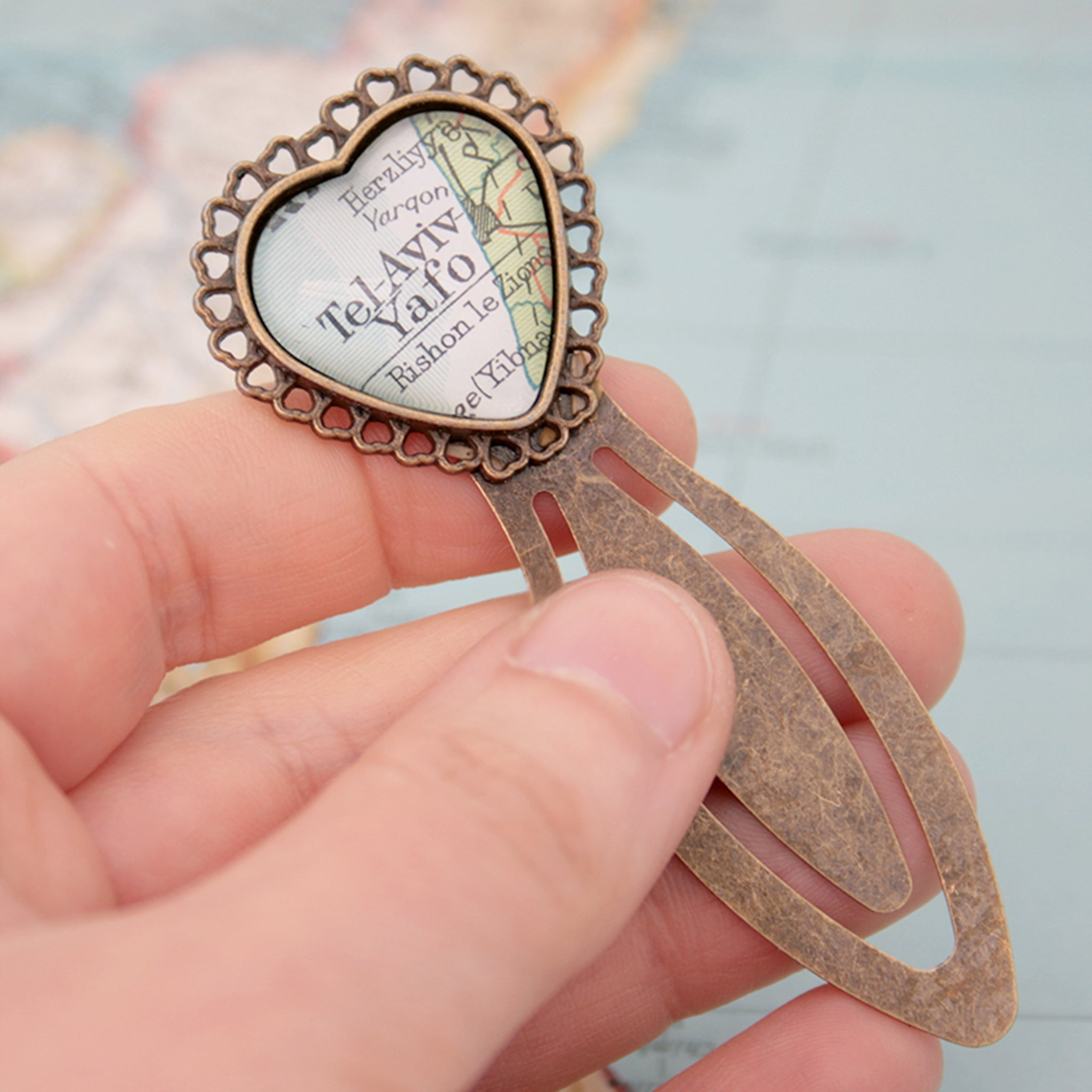 hold in hand metal bookmark in heart shape personalised with map of Tel Aviv