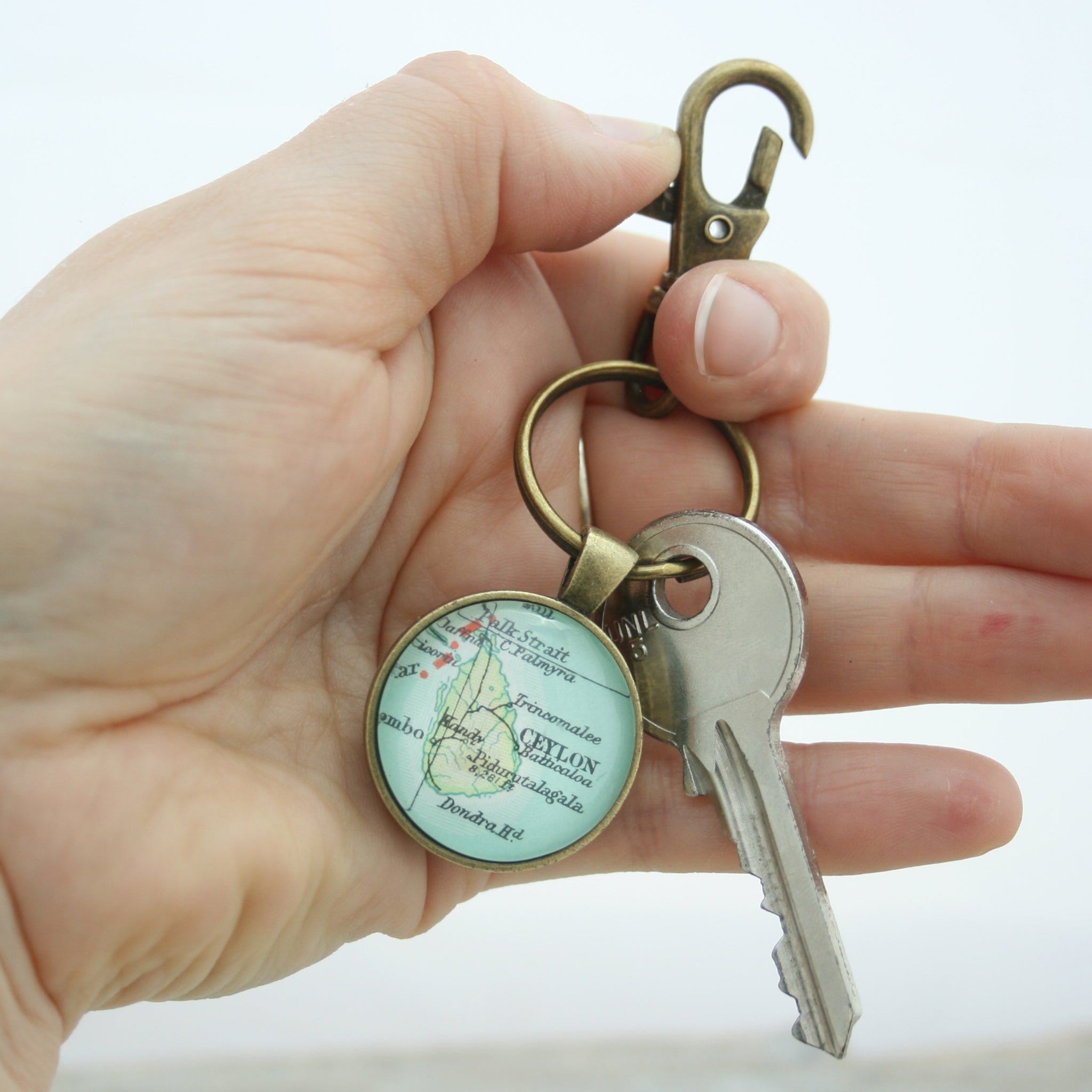 Hold in hand Personalised Keyring in bronze color featuring map of Ceylon