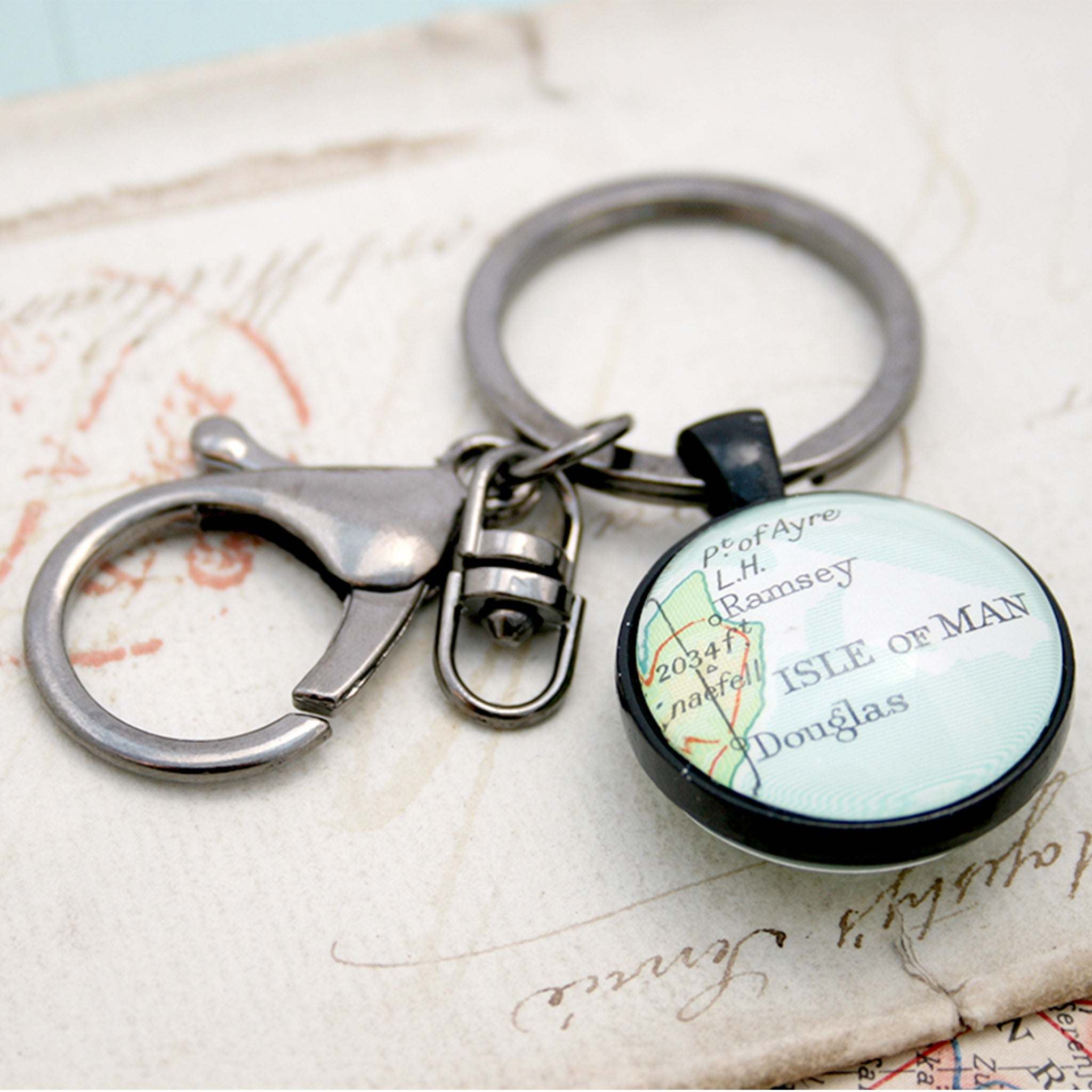 Personalised Keyring in black color featuring map of Isle of Man