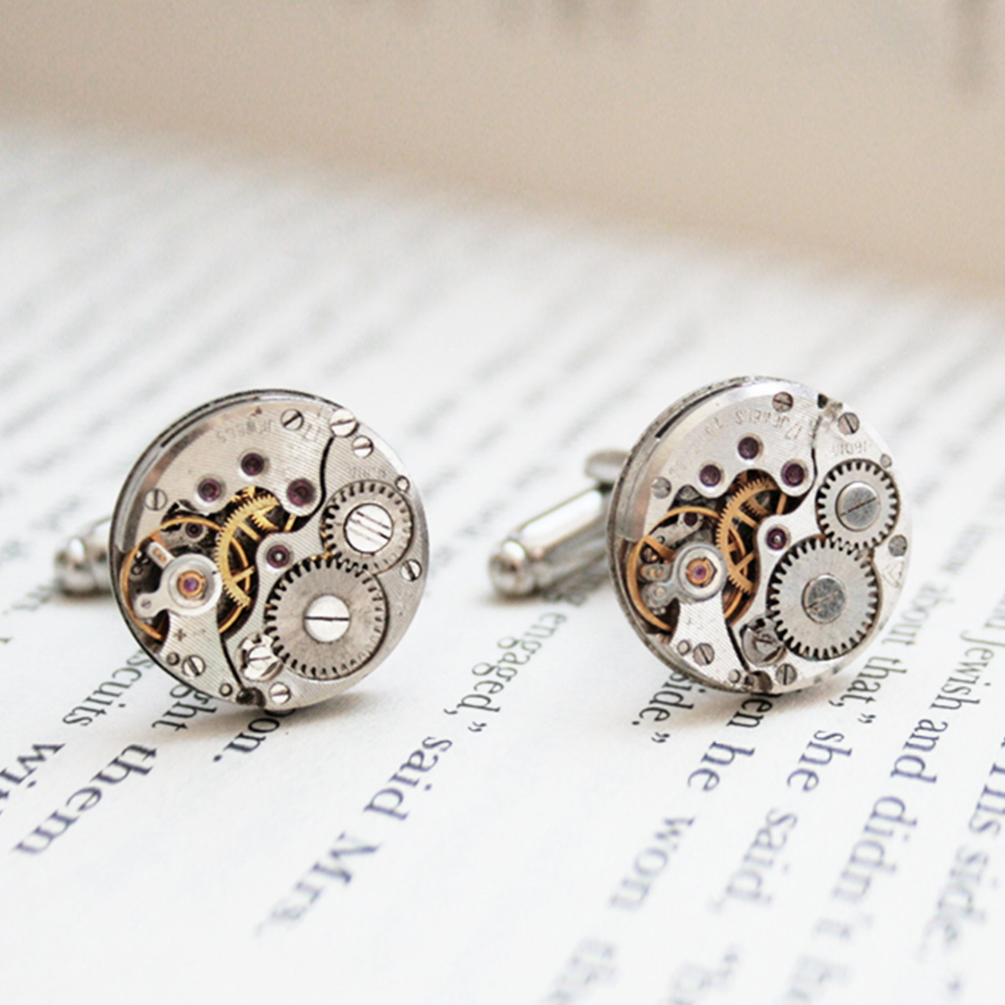 Round watch cufflinks in steampunk style featuring antique watch movements