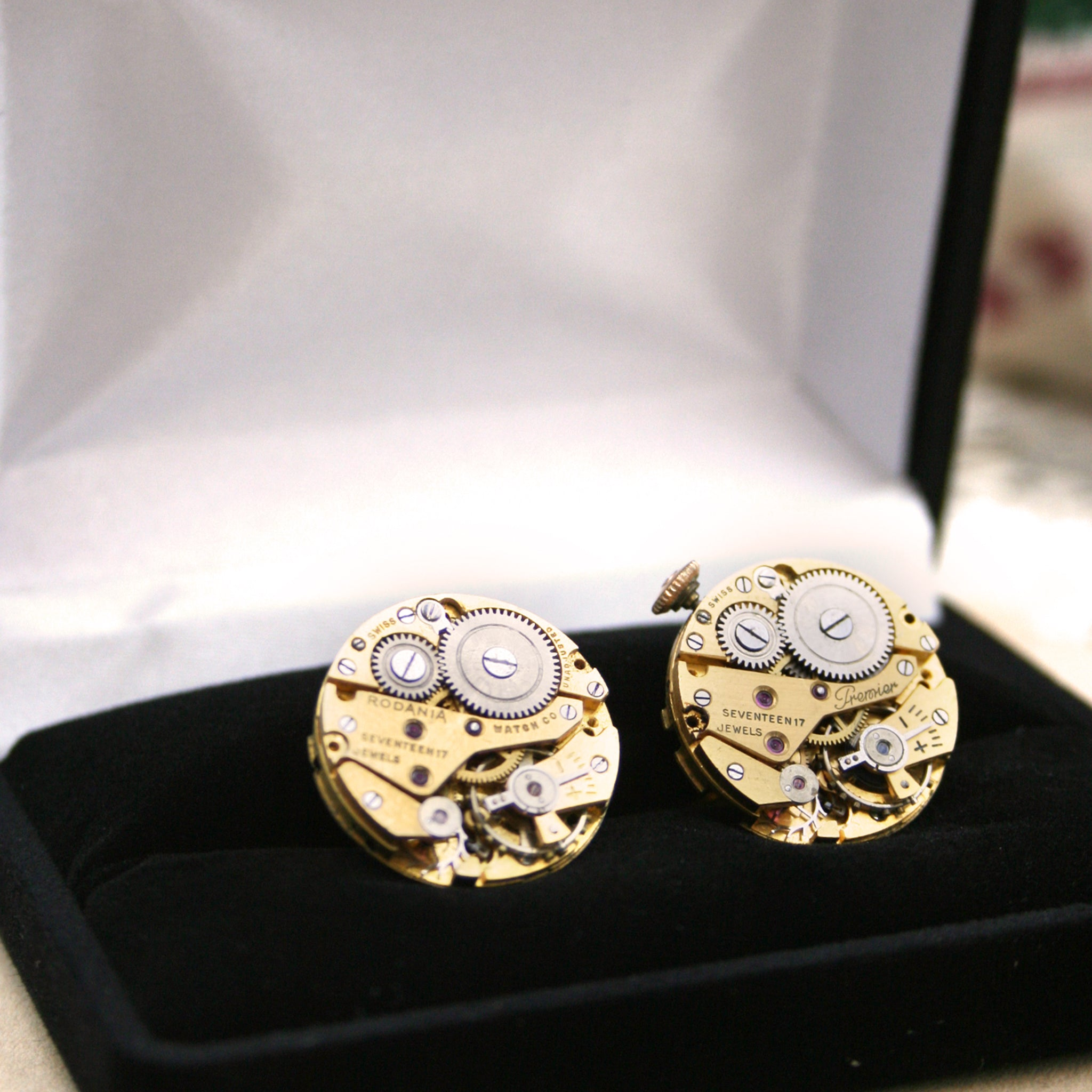 gold steampunk cufflinks featuring antique watch movements in a presentation box