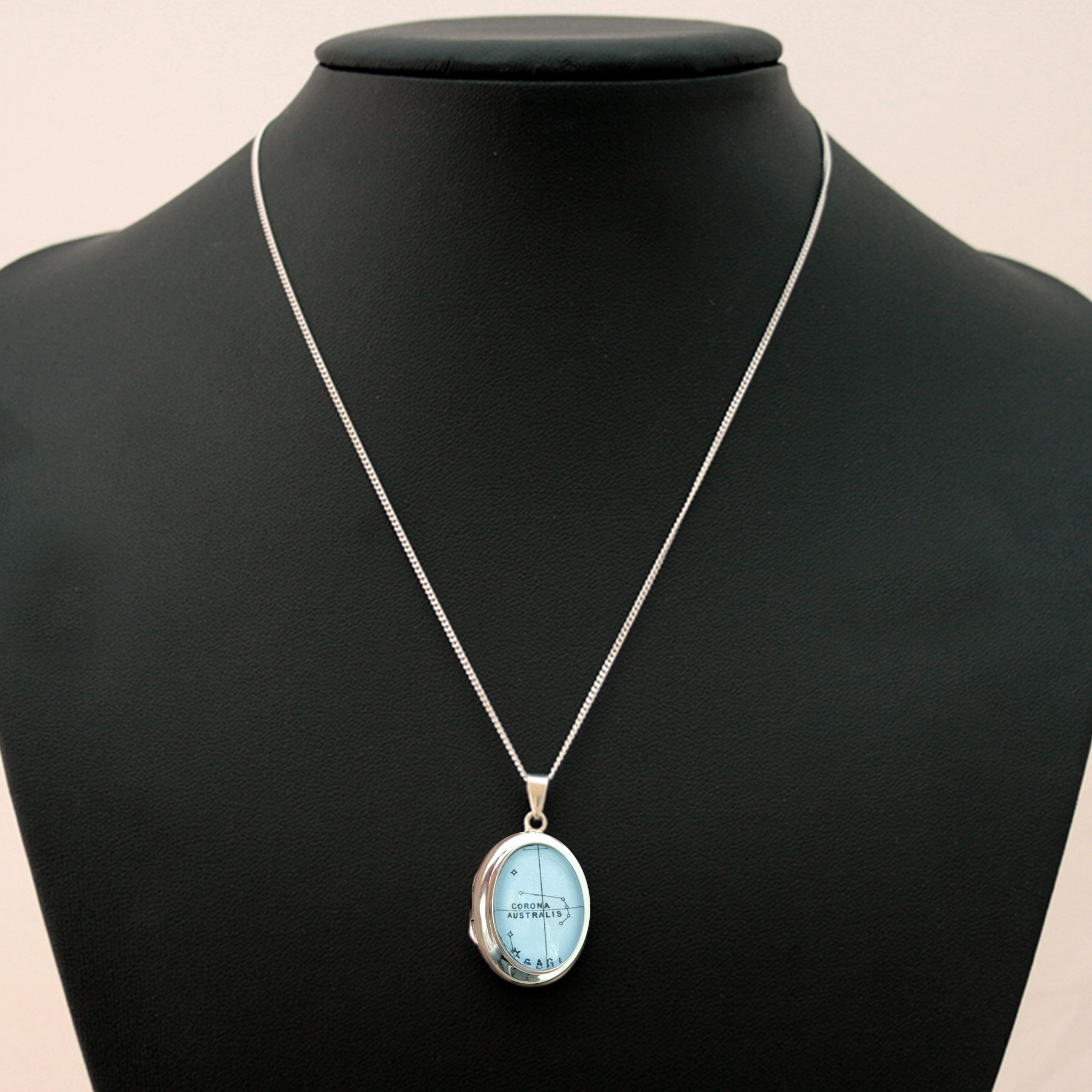 Sterling Silver locket necklace featuring map of Santa Cruz on bust