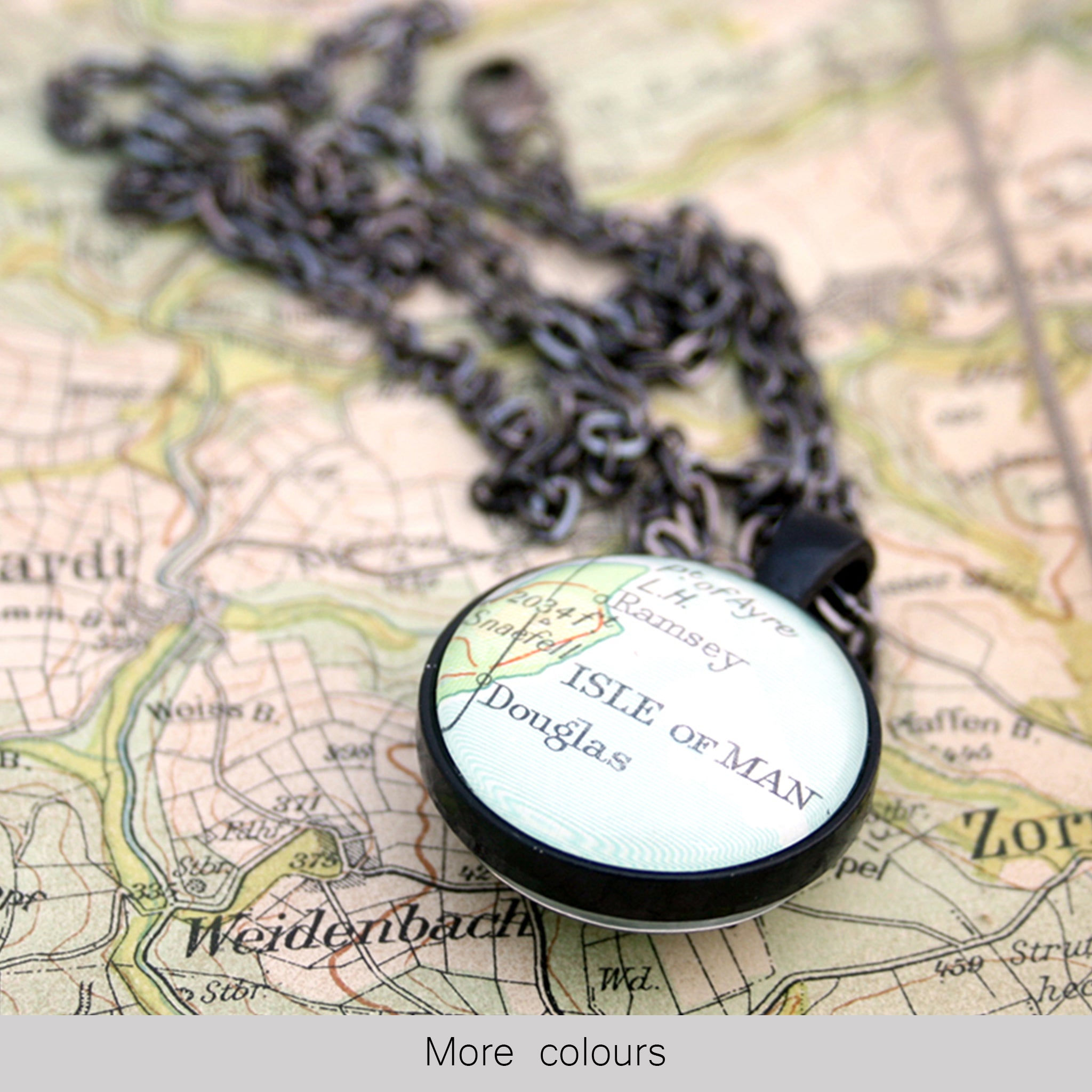 Black double sided pendant necklace featuring map of Isle of Man