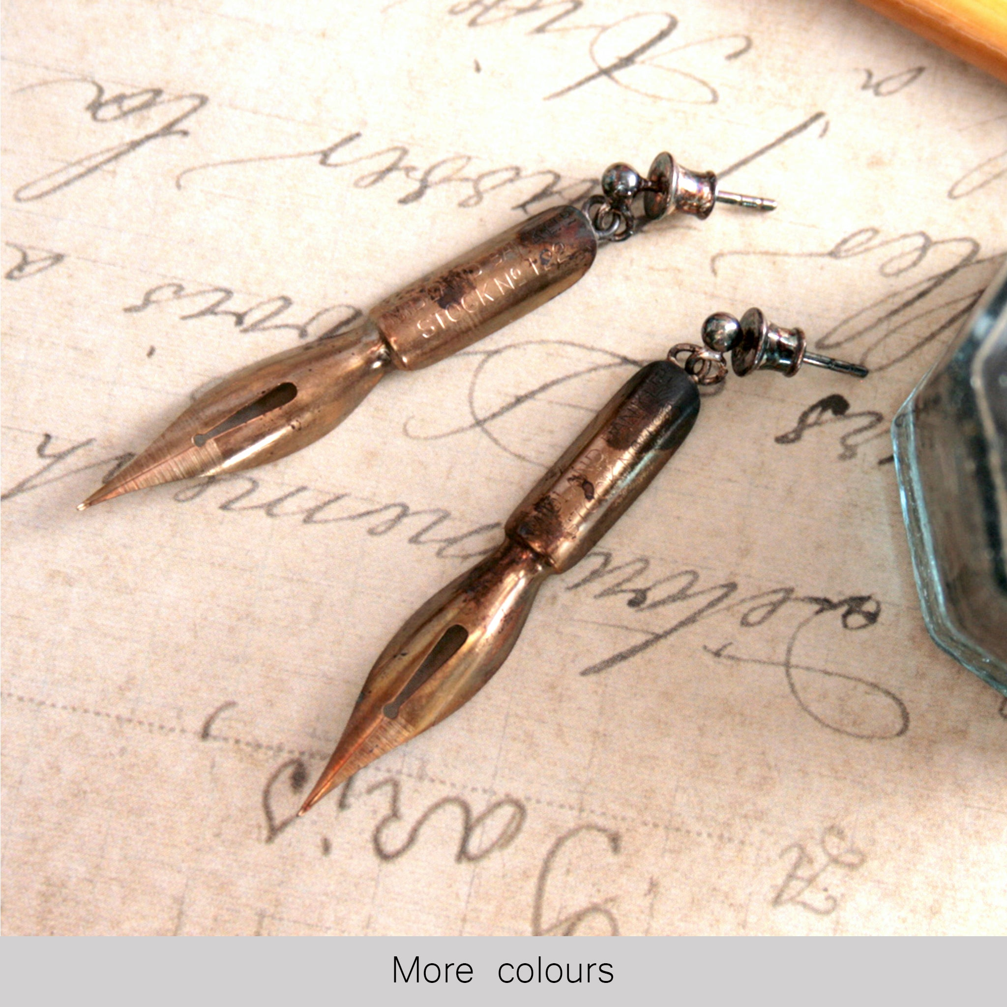 Long Dangle Pen Nib Earrings in gold color