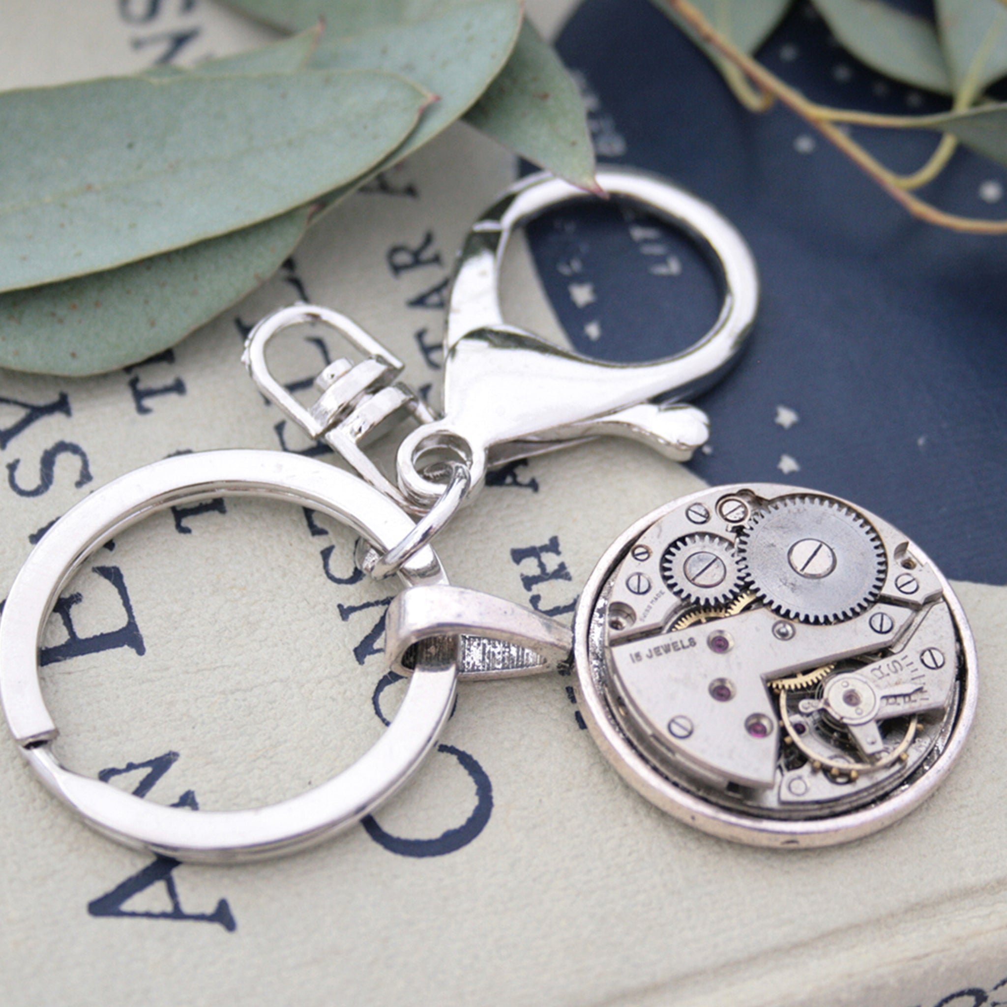 Very manly, steampunk keychain, made of real antique watch movement on metal base in silver tone