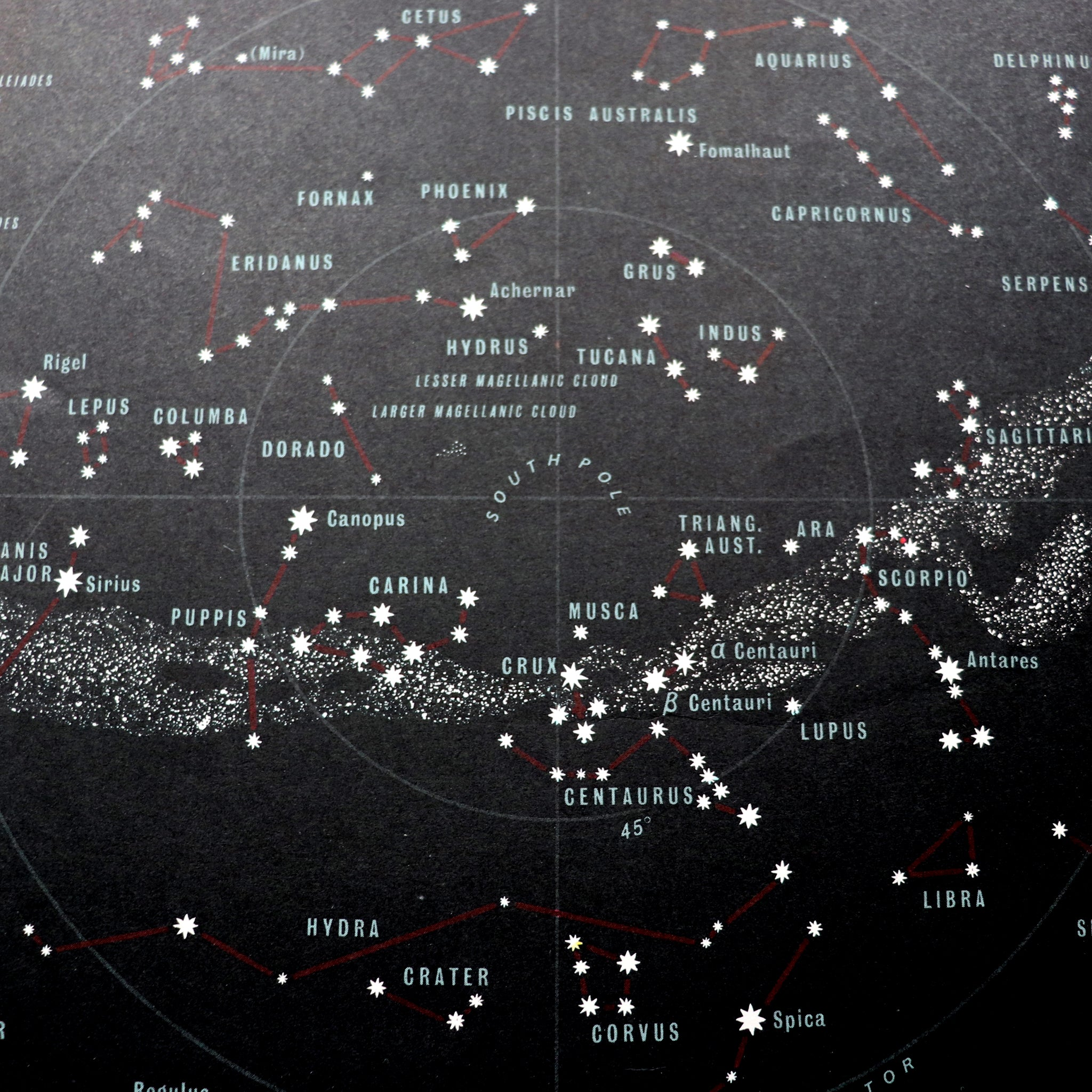 Black map of heavens featuring stars and constellations