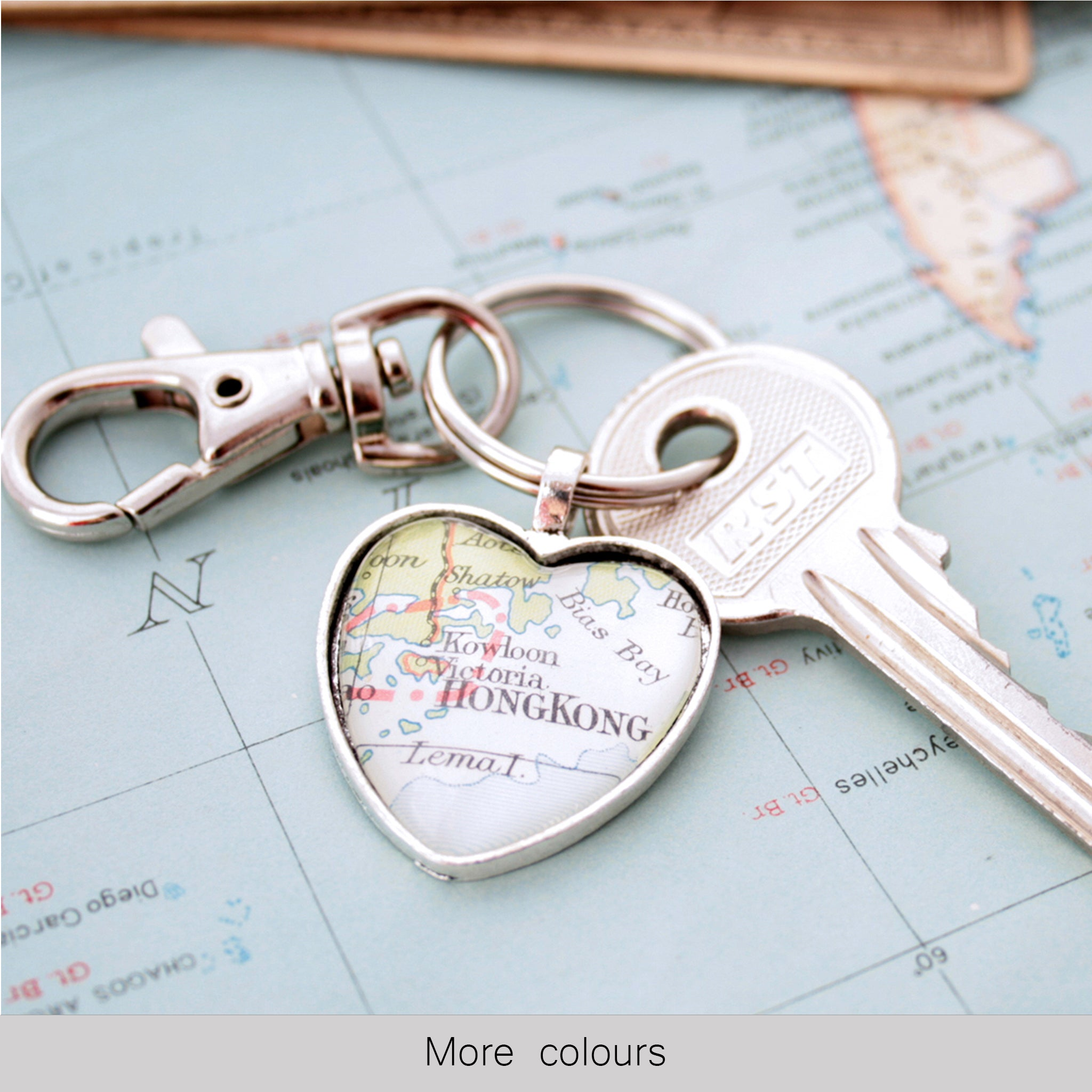 Heart shaped keychain in silver tone featuring map of Hong Kong