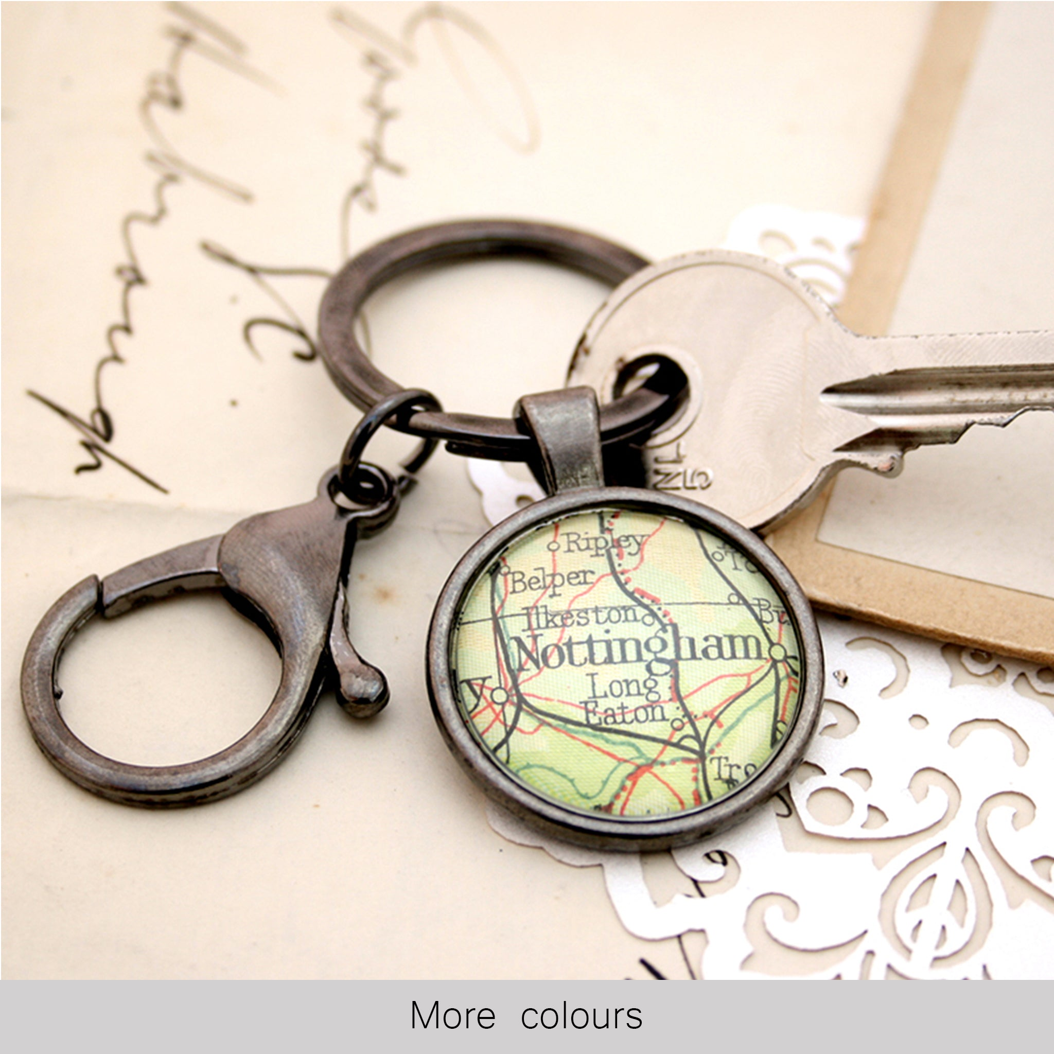 Personalised keyring in gunmetal black color featuring map of Nottingham