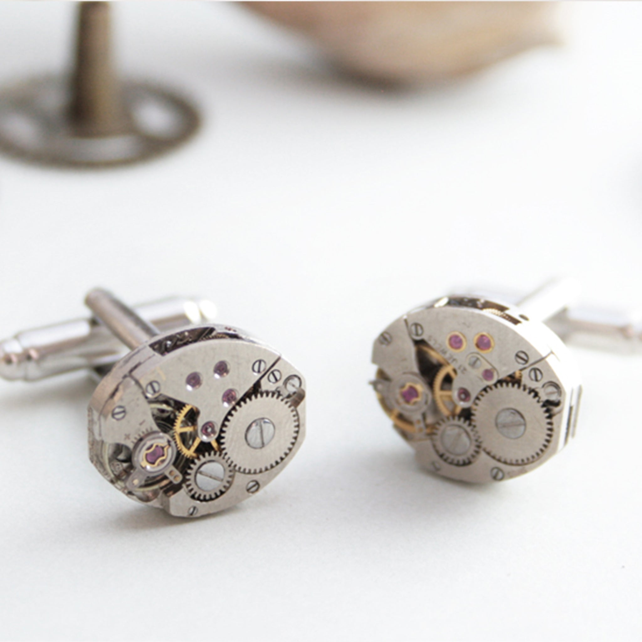 Cufflinks featuring old clock parts