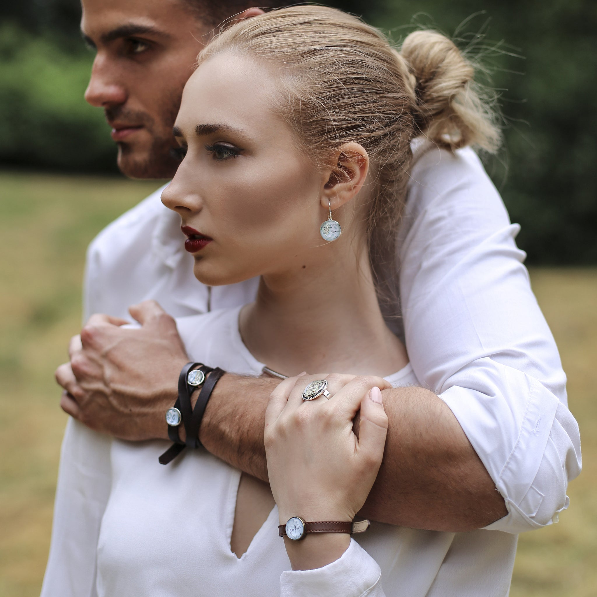 Model wearing Black leather bracelet with custom map location bead