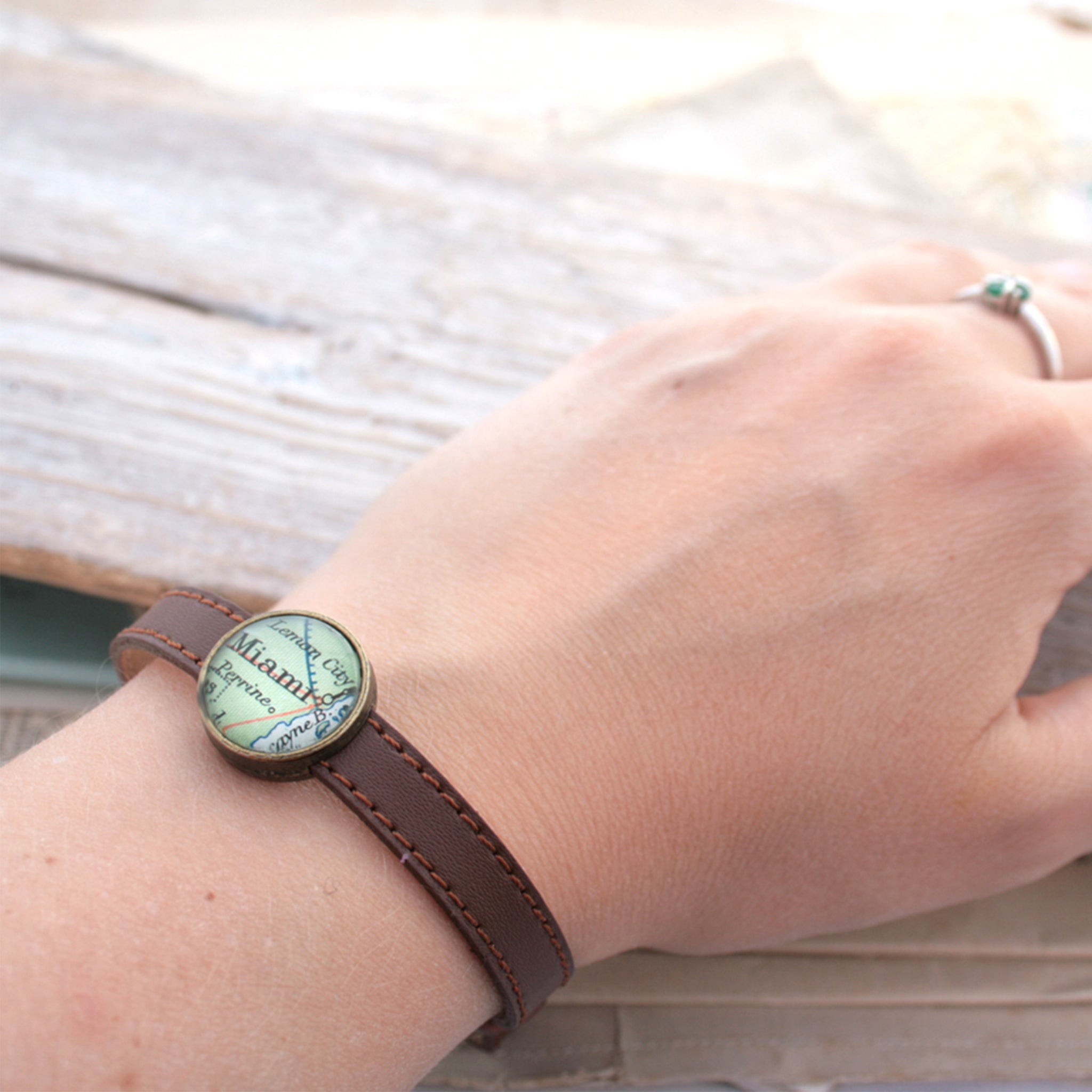 Worn on hand Brown leather bracelet with custom map location bead