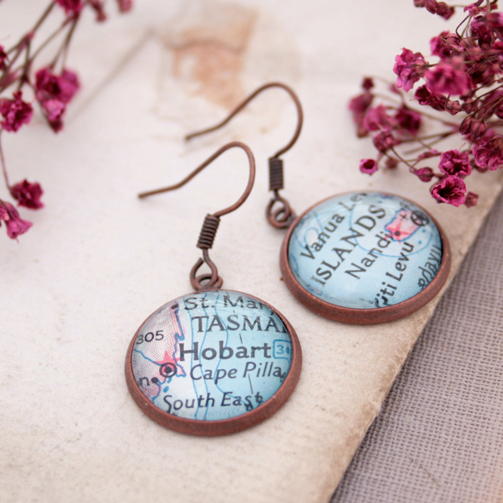 Copper dangle earrings featuring maps of Hobart